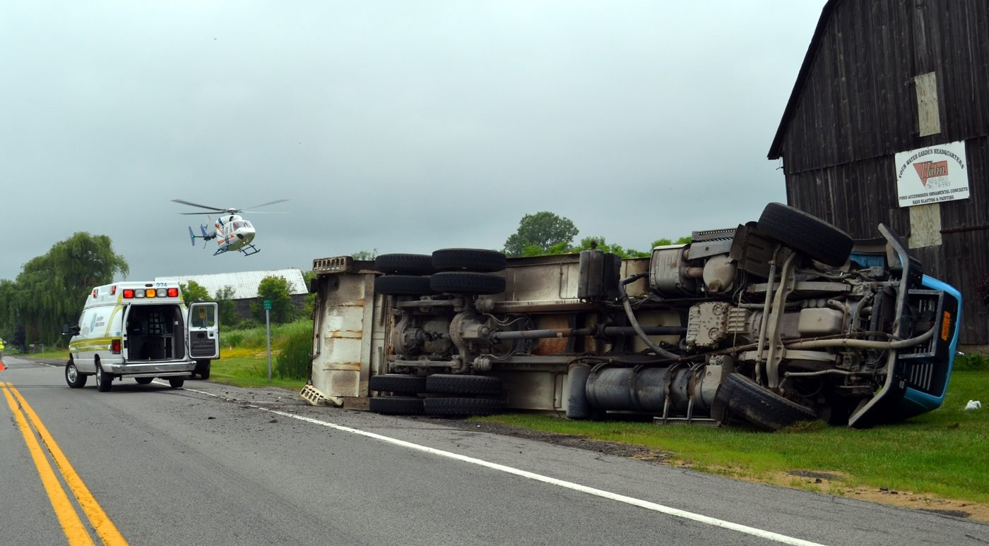 The overturned garbage truck near Shawnee Road and Lower Mountain Road in Cambria.
