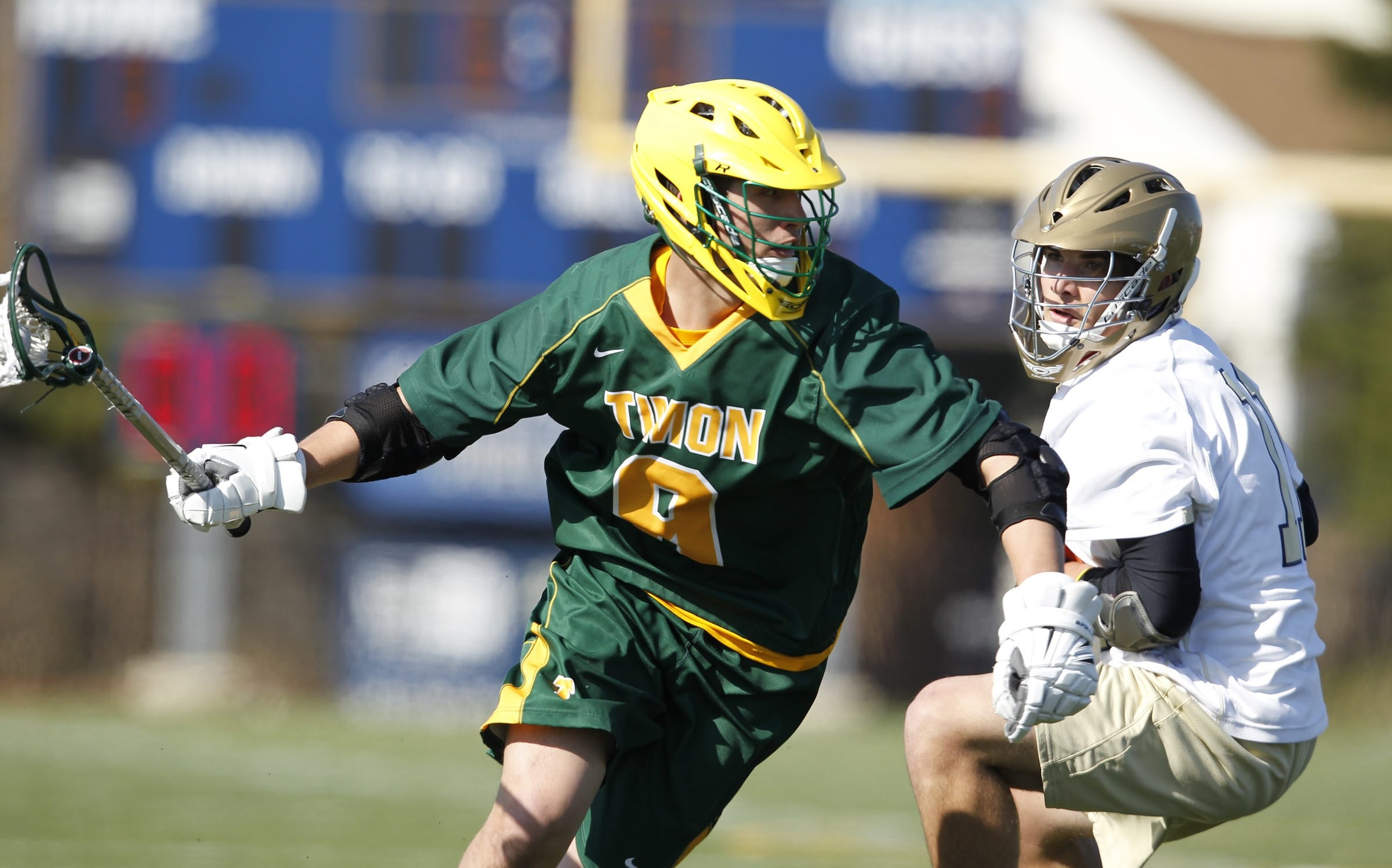 Bishop Timon player Adam Dimillo (9) drives around Canisius player Jakob Loucks (11) during action at the Robert J. Stransky Memorial Athletic Complex on, Thursday, April 24, 2014. {Photo by}