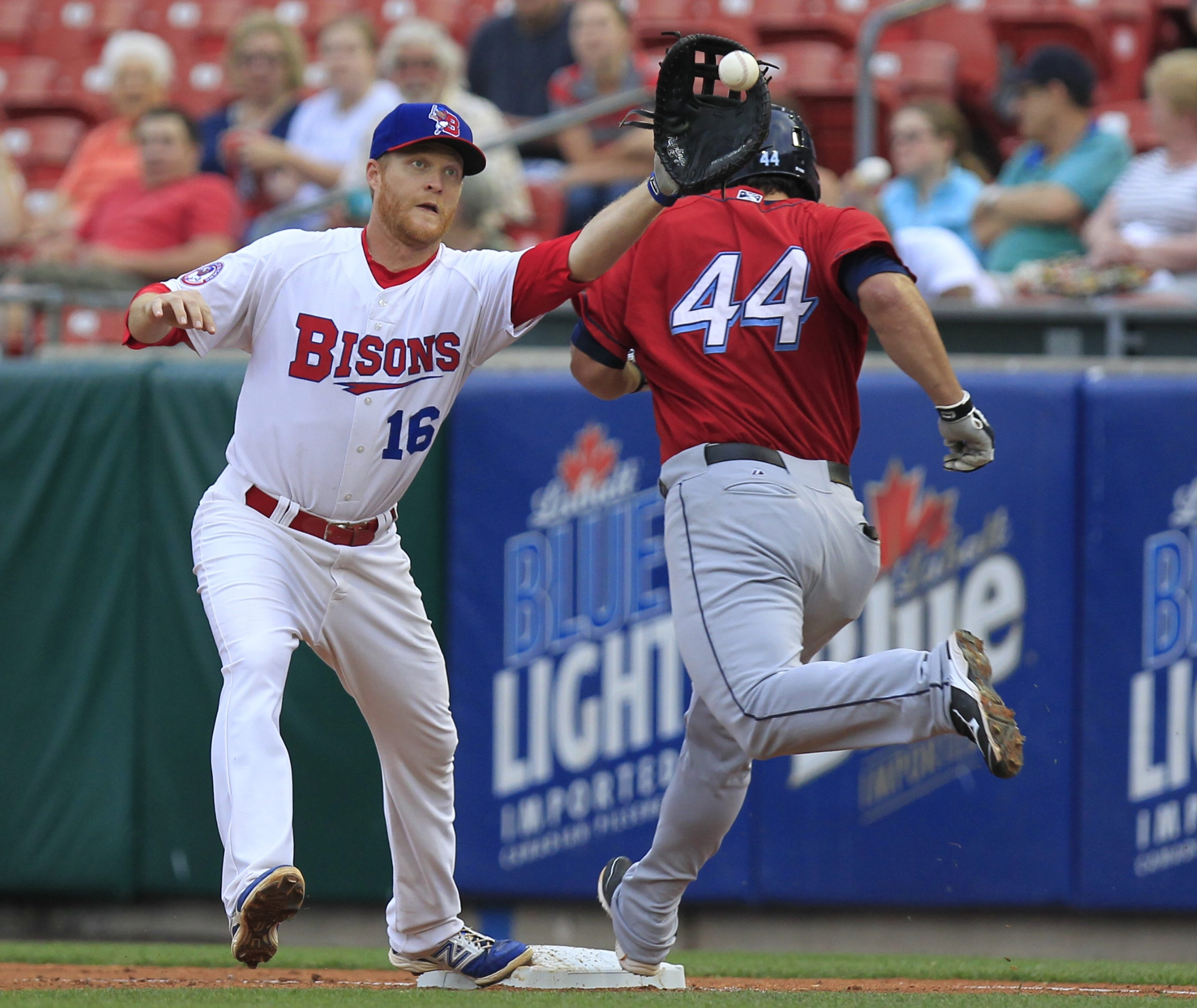 Bisons first baseman Dan Johnson stretches to tag out Clippers' Adam Abraham on Tuesday.