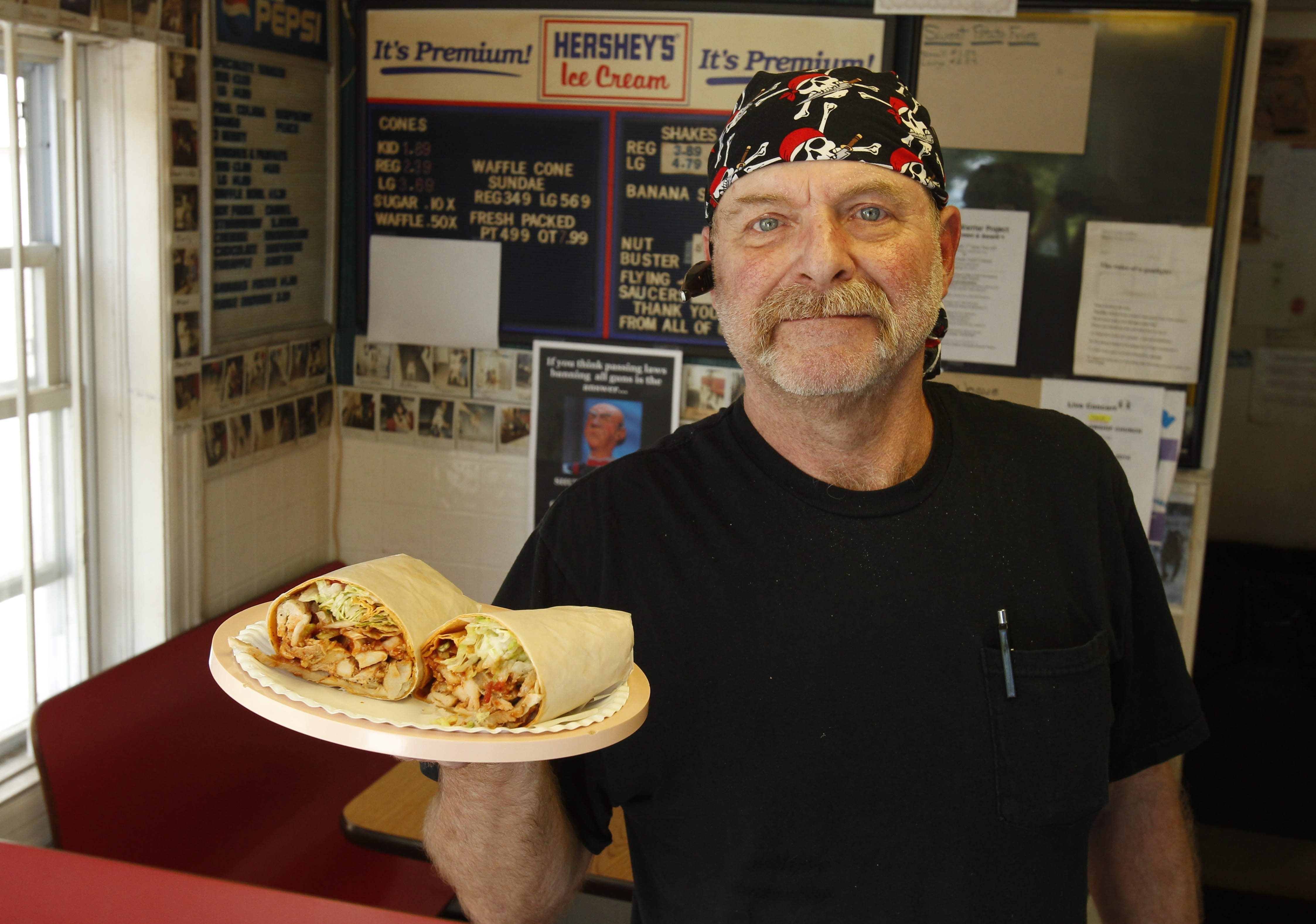 Owner Les Winters shows off a large chicken taco.