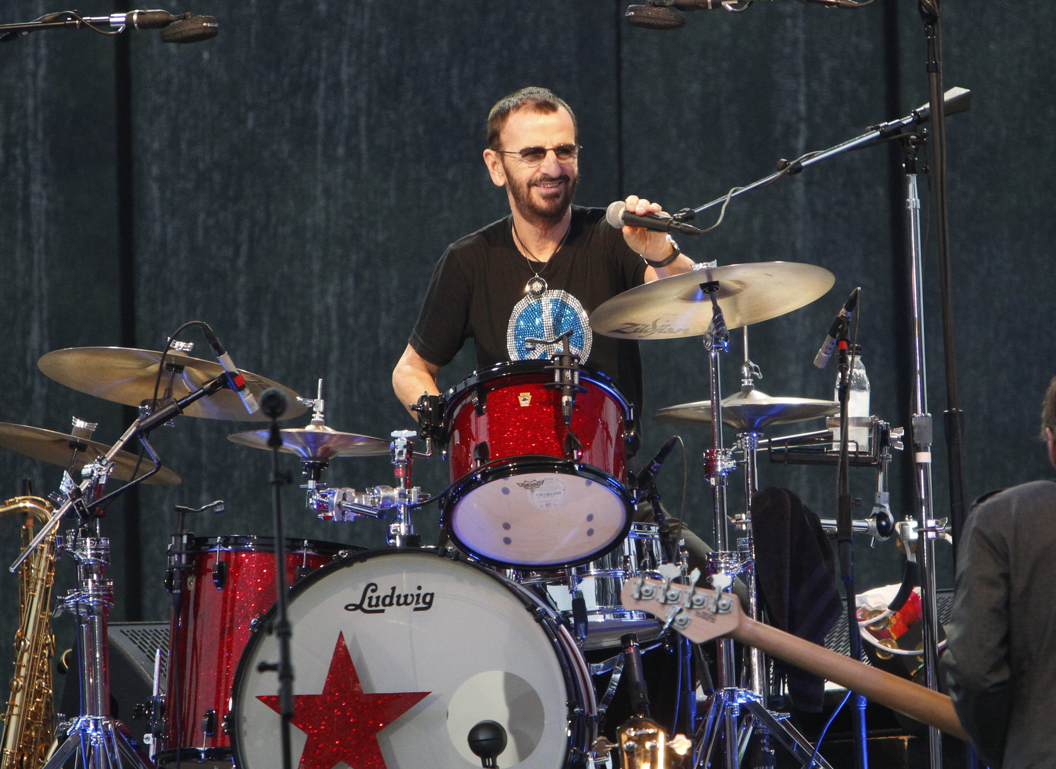 Ringo Starr and his All-Starr Band performed at Artpark's Tuesday in the Park, Tuesday, June 24, 2014. There was a half-hour rain delay as the clouds opened up shortly before they started. Then the rain passed and the show went  on.  (Sharon Cantillon/Buffalo News)
