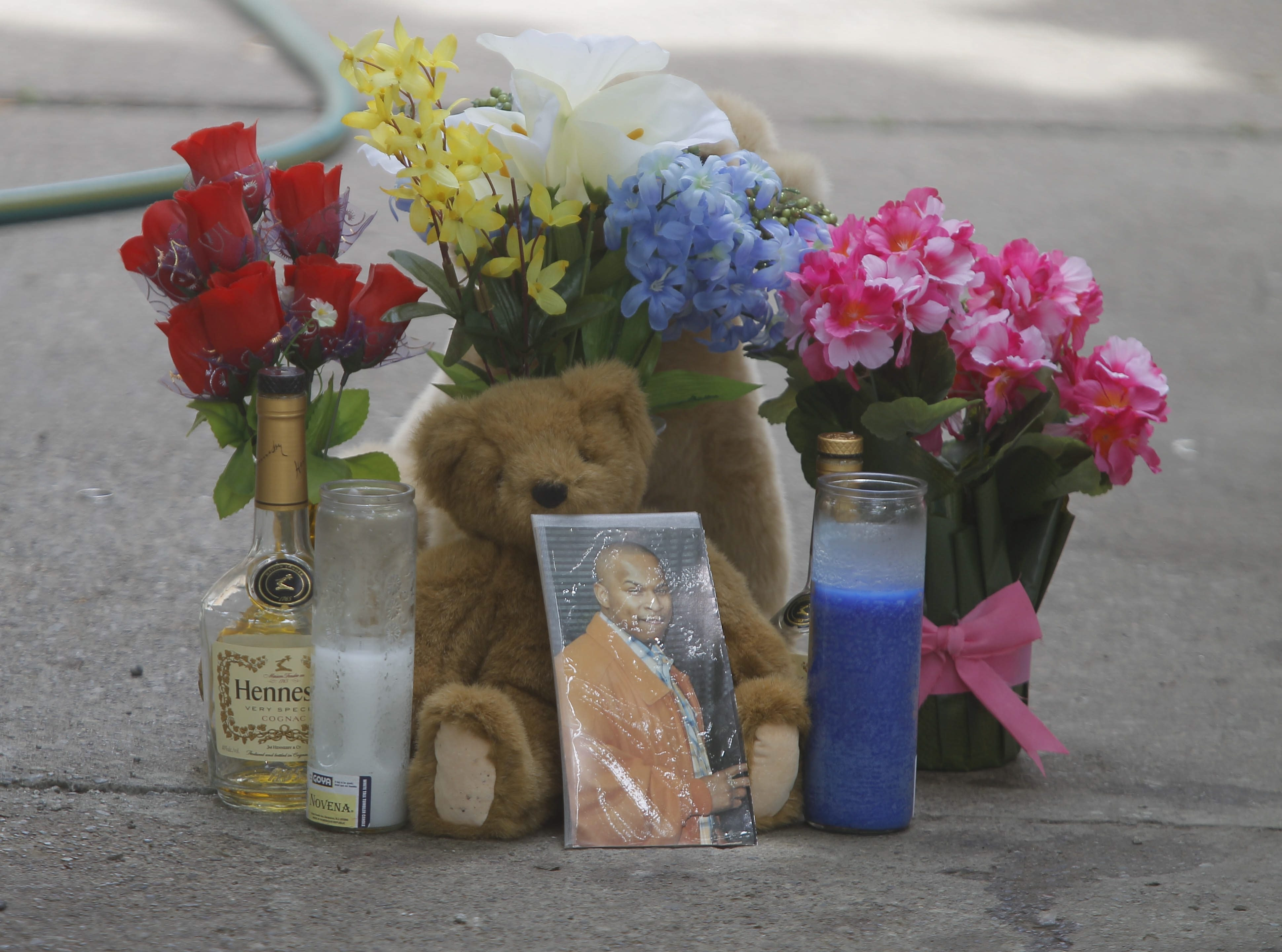 Memorial to Deshawn White in front of home where he was gunned down at  105 St. Joseph Street   in Buffalo, N.Y.  on Monday, June 23, 2014.   (John Hickey/Buffalo News)