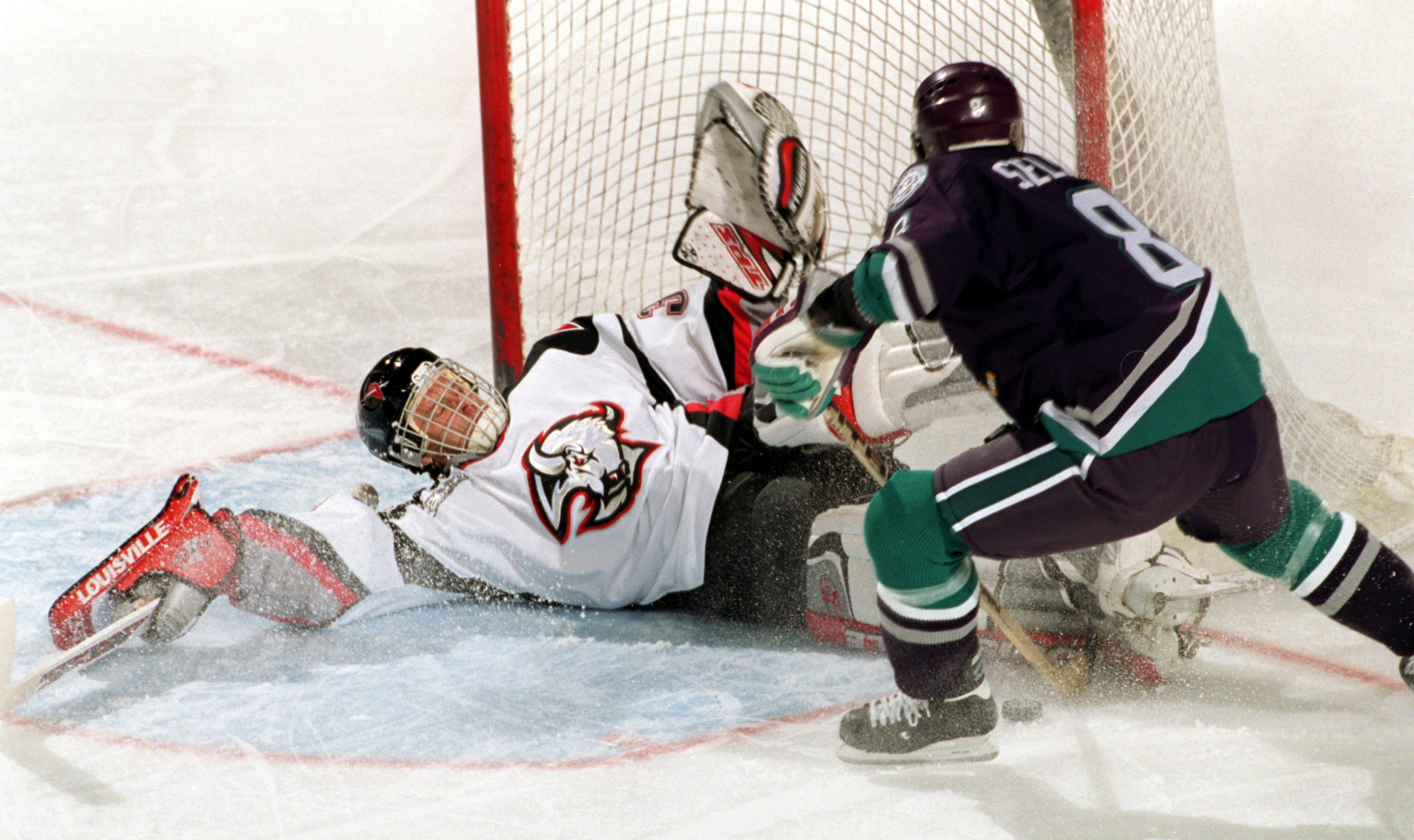 Buffalo Sabres Dominik Hasek denies Anaheim's Teemu Selanne, one of the many players Hasek stonewalled during his Hall of Fame career. Hasek led the league in save percentage six straight seasons and still holds the Sabres record for career shutouts (55). (Harry Scull Jr./Buffalo News file photo)