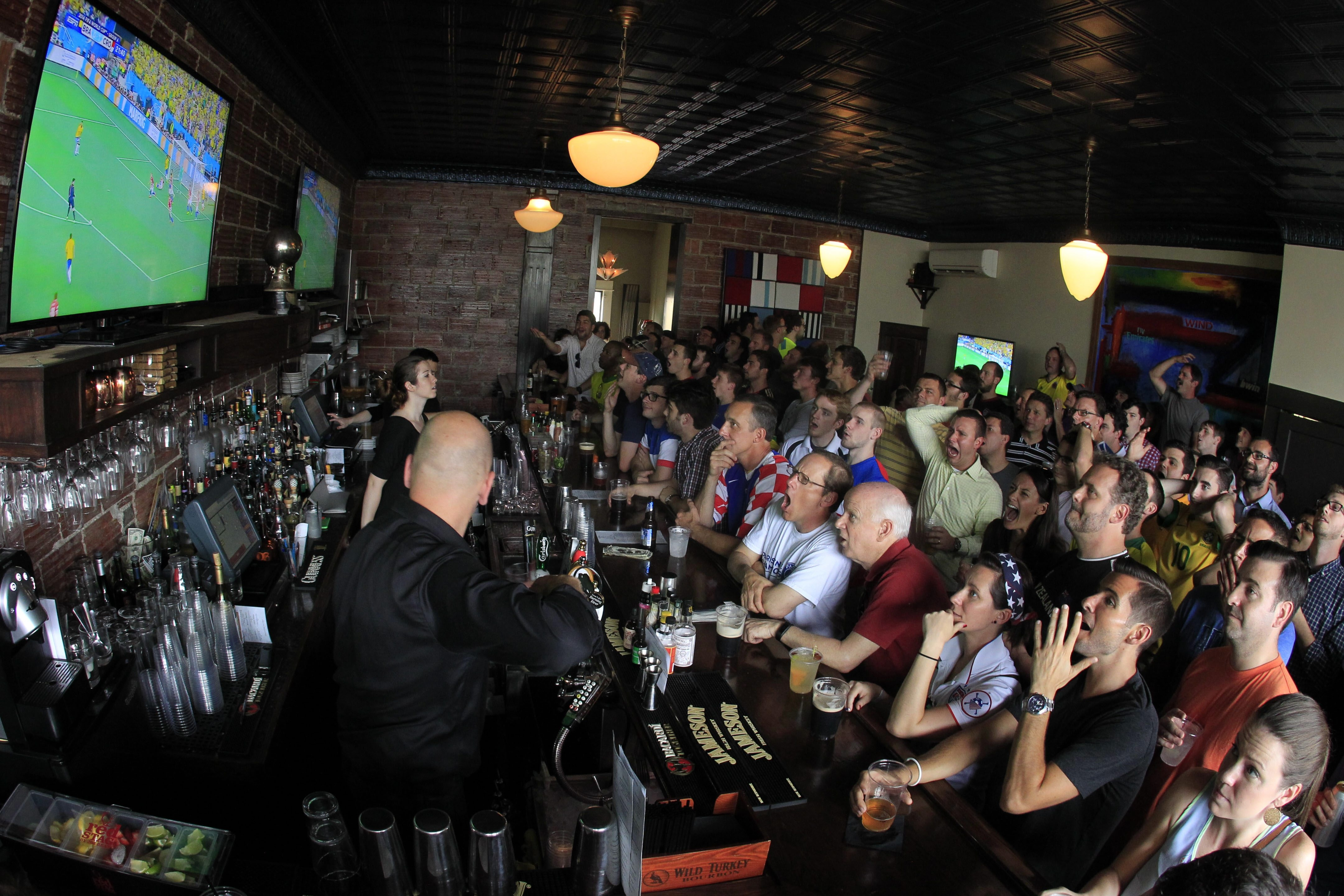 Soccer fans watch the World Cup at Mes Que Bar on Thursday, June 12, 2014. (Harry Scull Jr./Buffalo News)