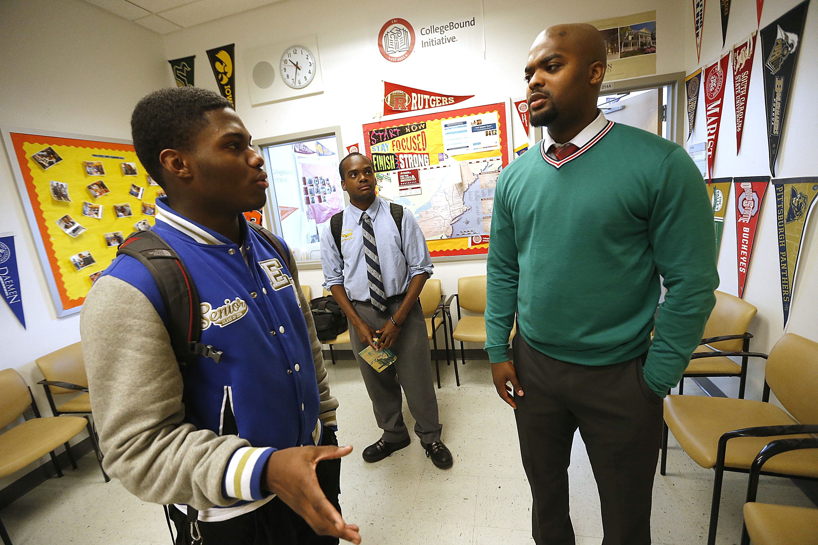 College counseling director Kareem Donaldson, right, discusses the transition from high school to college with Roshane Gray, left, and Zimba Hamm, center.
