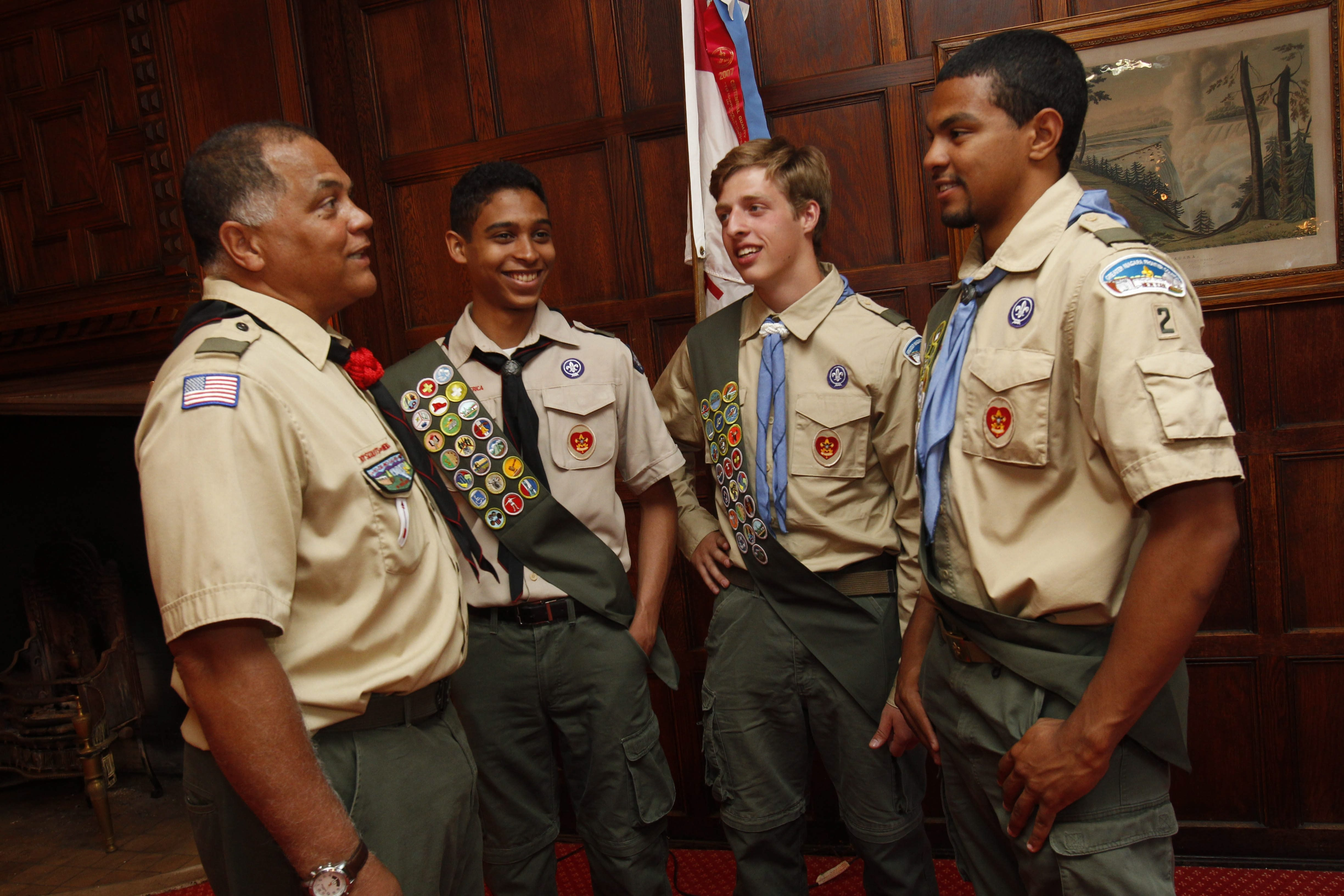 Troop 2 Scoutmaster Edward Hughes, left, speaks with Luis Castro, Michael Cornacchio and his son Evan Hughes before they received their Eagle Scout badges at a ceremony at The Saturn Club on Saturday.