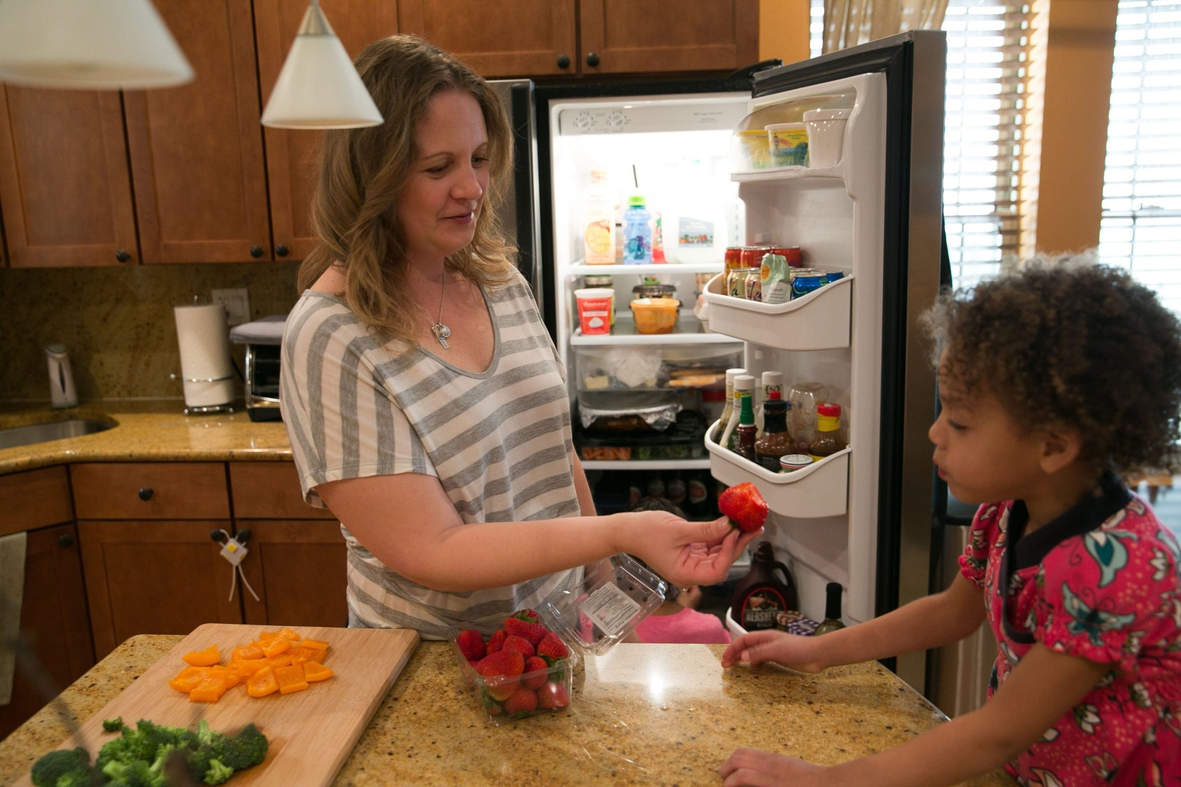 Jennifer Leigh, seen with her daughter Janelle at their home in Evanston, Ill., lost her sense of smell in her 20s. She has adapted to daily tasks such as cooking by relying on past experience.
