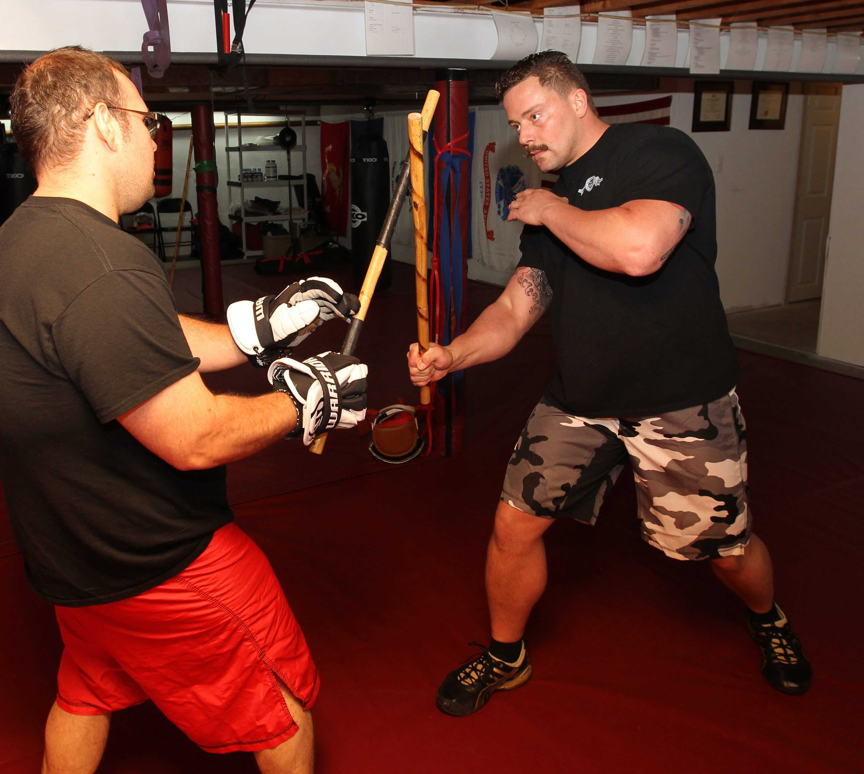 John Lehmann, right, and Michael Wagner employ 12 angles of attack in stick fighting.