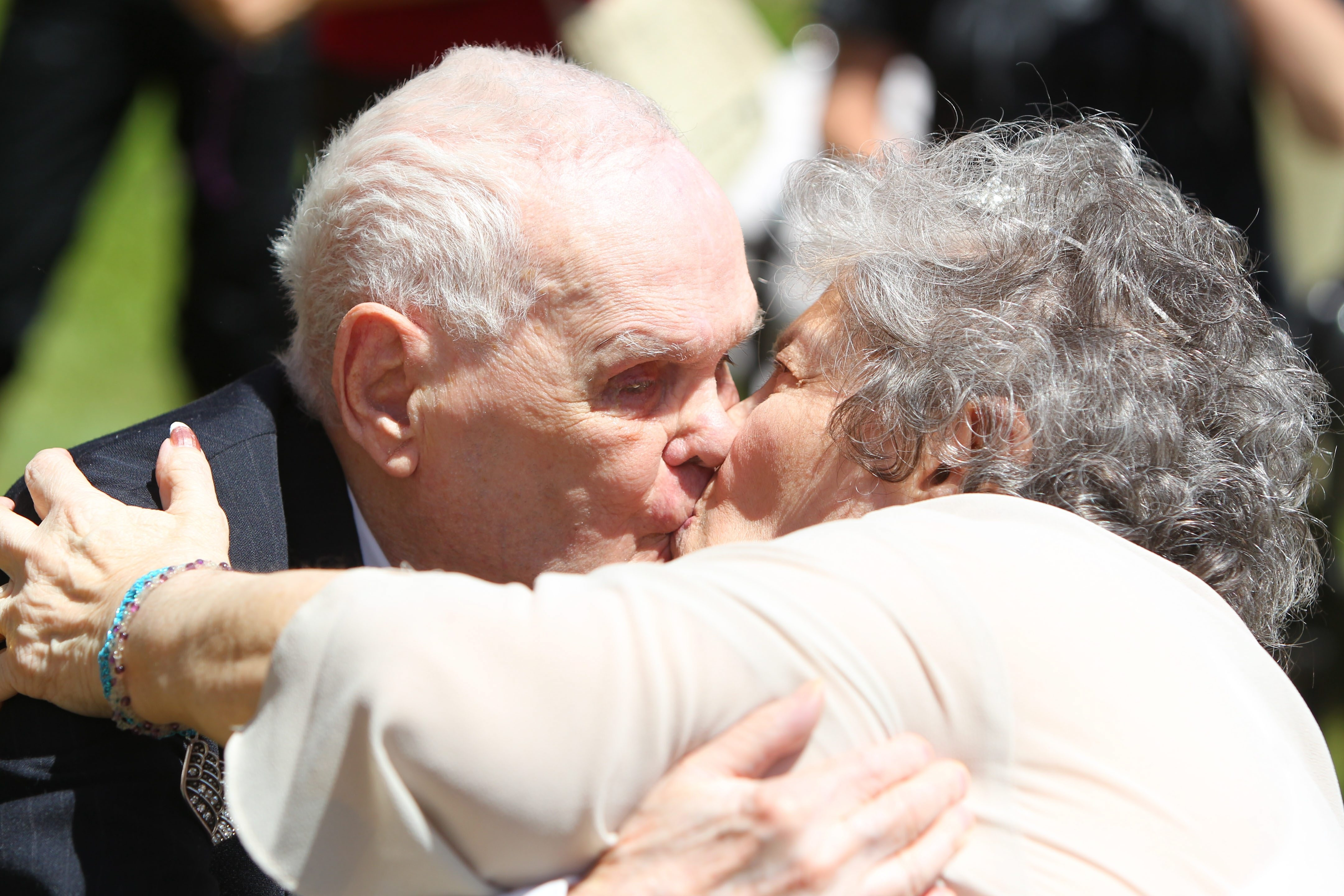 Robert Gagnon kisses Charlotte Abounader during their wedding Thursday. See a photo gallery at BuffaloNews.com.