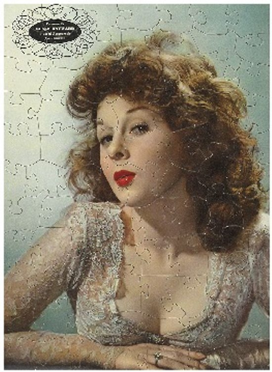 This jigsaw puzzle pictures Susan Hayward. She was born in 1917 and stopped making movies about 1972. The puzzle was one of seven novelties that sold as a group for $250 at a Swann Galleries auction in New York in April 2014.