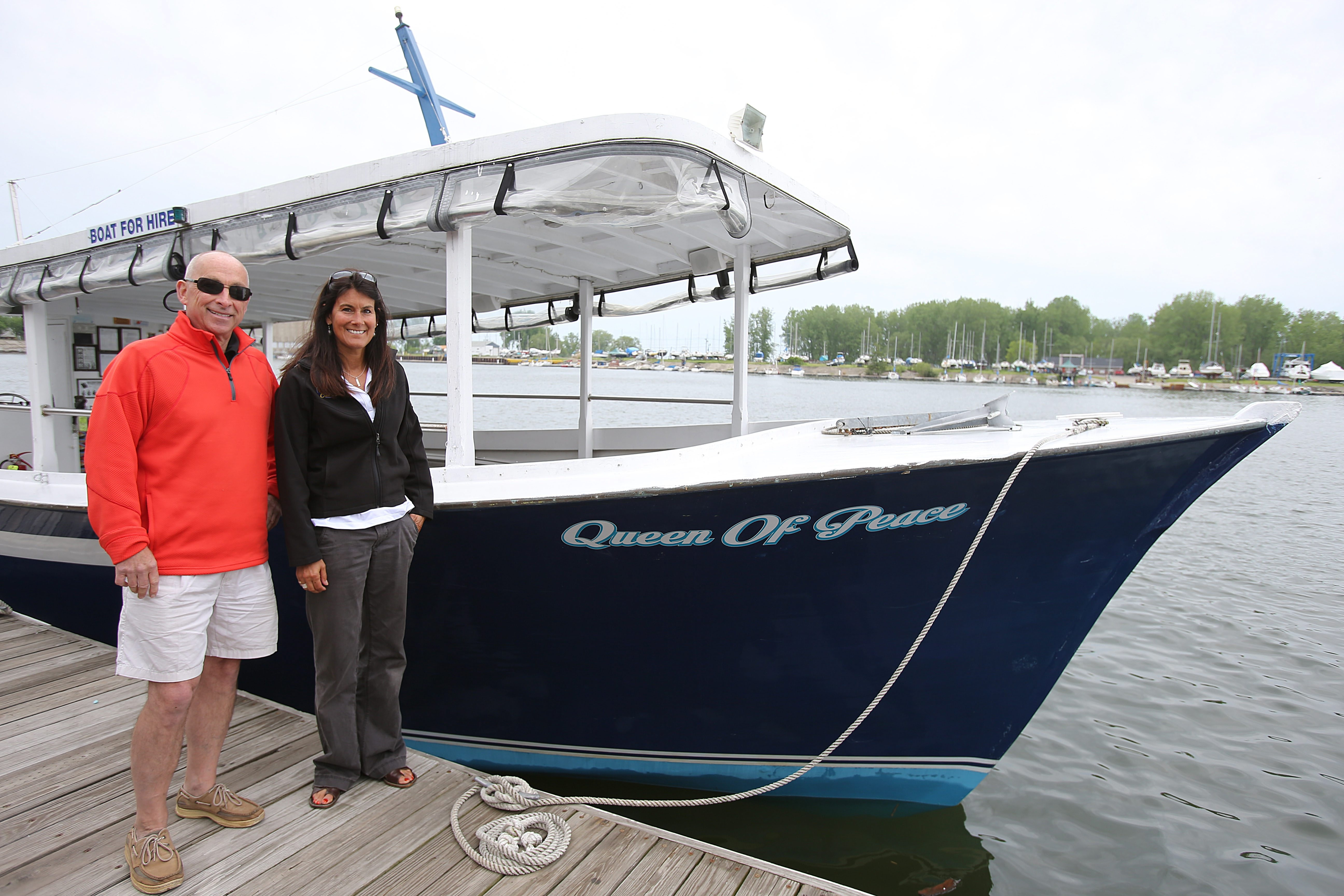 Co-owners Tom Hauser and Robin Hoch with their boat, the Queen of Peace, which will be plying the waters for this summer's Niagara River Cruises.