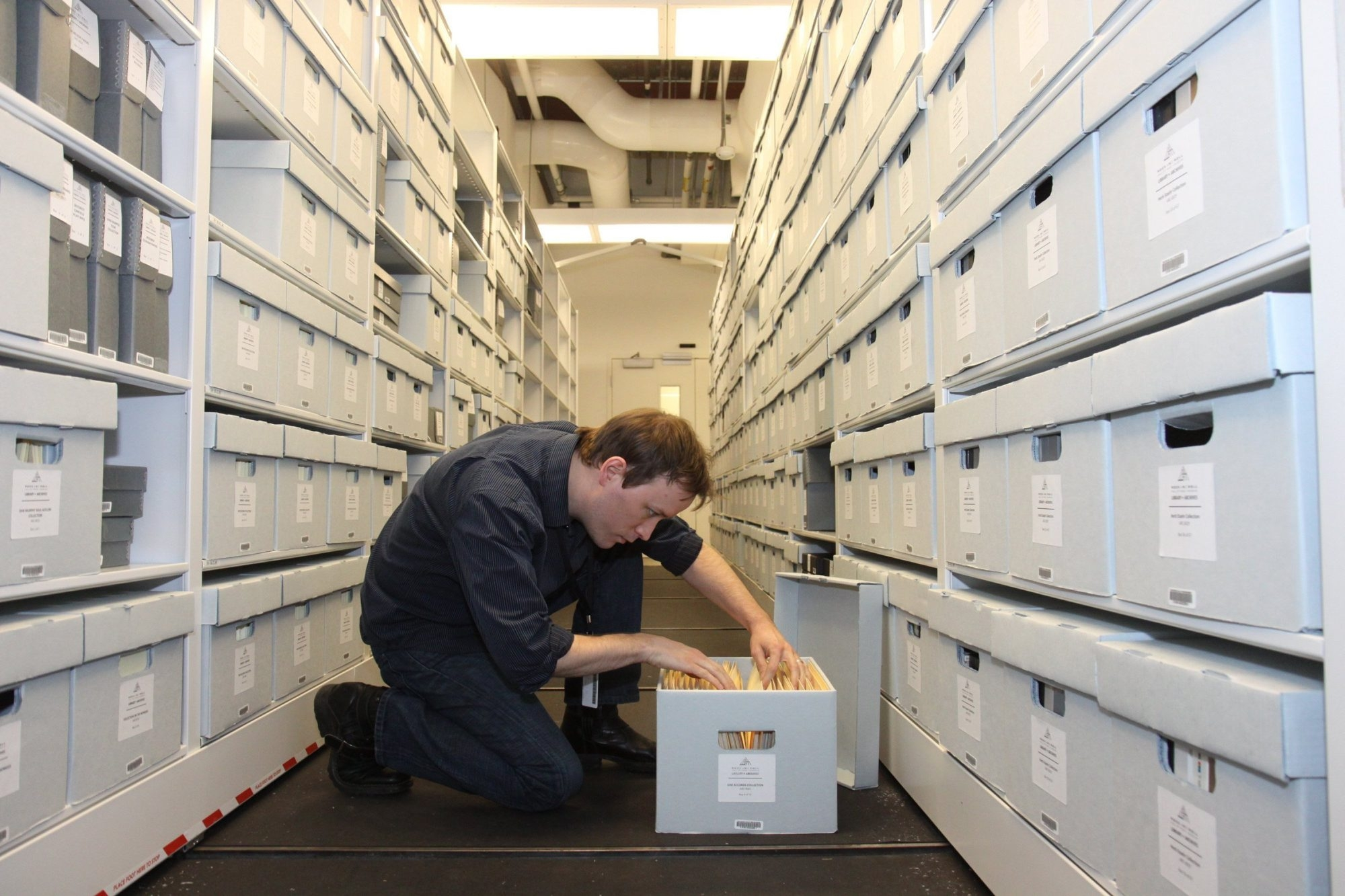 Andy Leach, the director of the Library and Archives of the Rock and Roll Hall of Fame, looks through the collection.