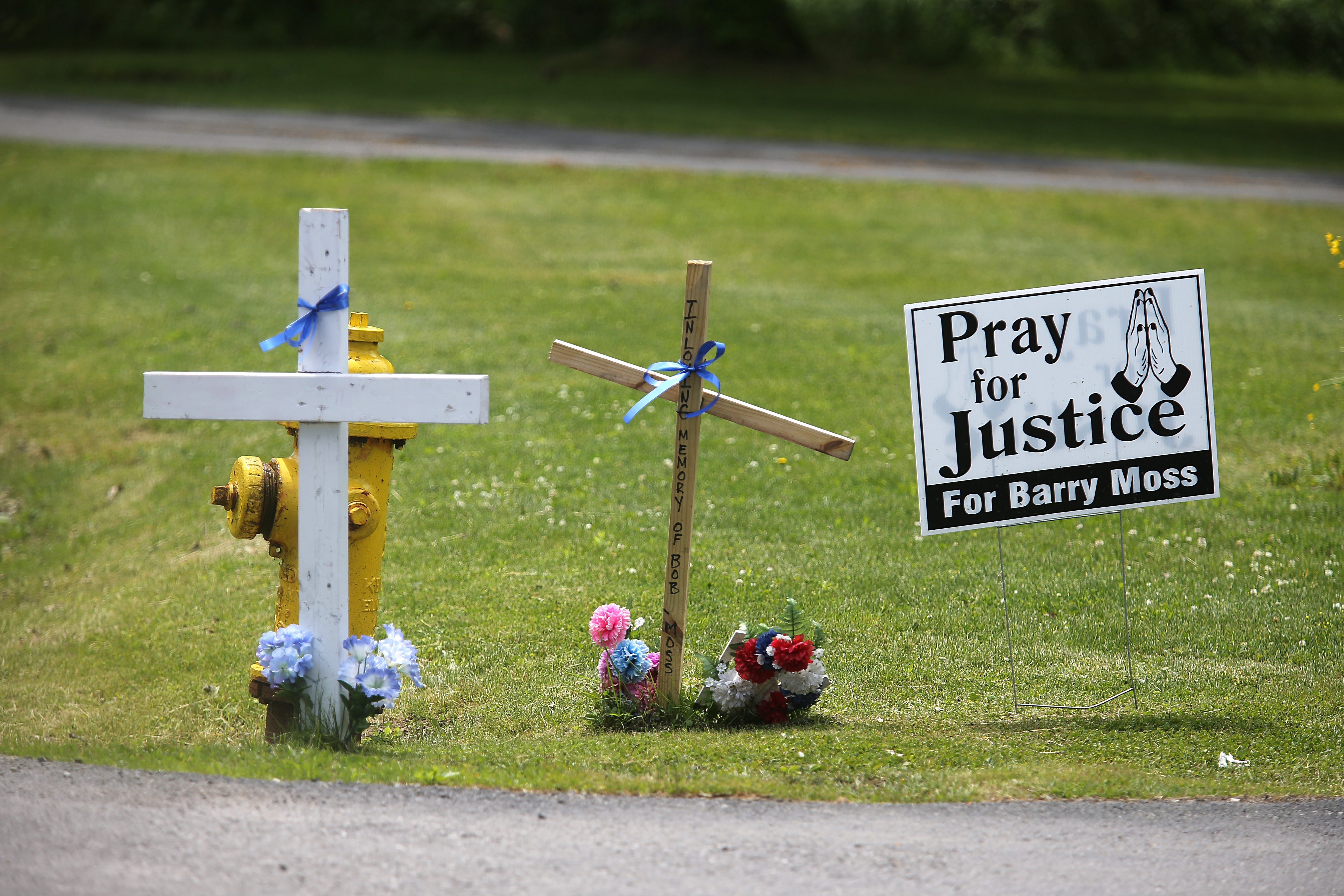 A memorial for Barry Moss, who was struck and killed by a vehicle on Rt. 5 near Gold St. in Evans.  (Charles Lewis/Buffalo News)