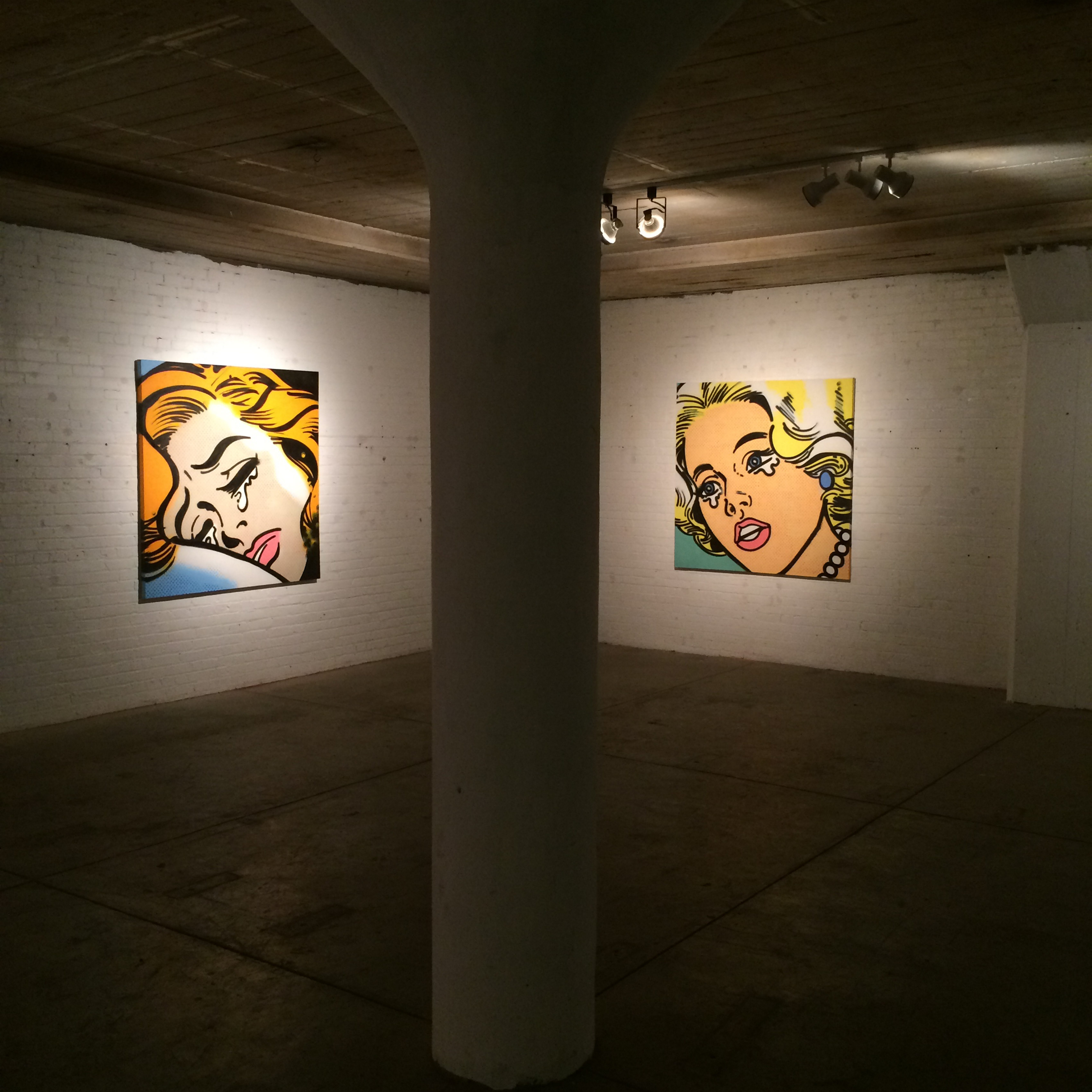 """Paintings by Athena Page hang in Hi-Temp Fabrication through June 27 as part of her """"Sad Girls"""" exhibition."""