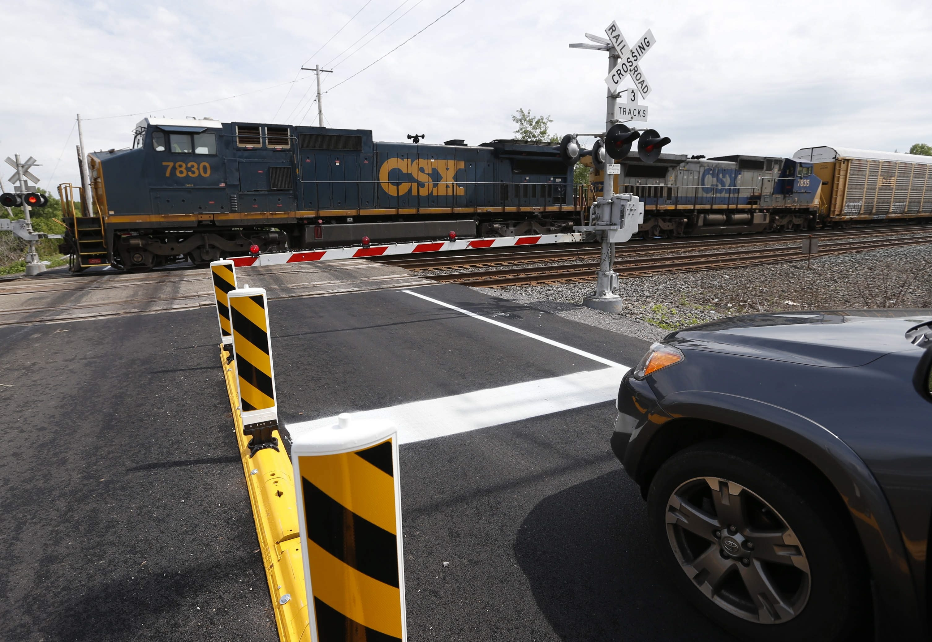 """A vehicle waits at the railroad crossing on Rogers Road in Hamburg last week. The crossing next week will become a """"quiet zone,"""" which means trains will no longer be required to blow warning signals as they approach and enter the crossing."""