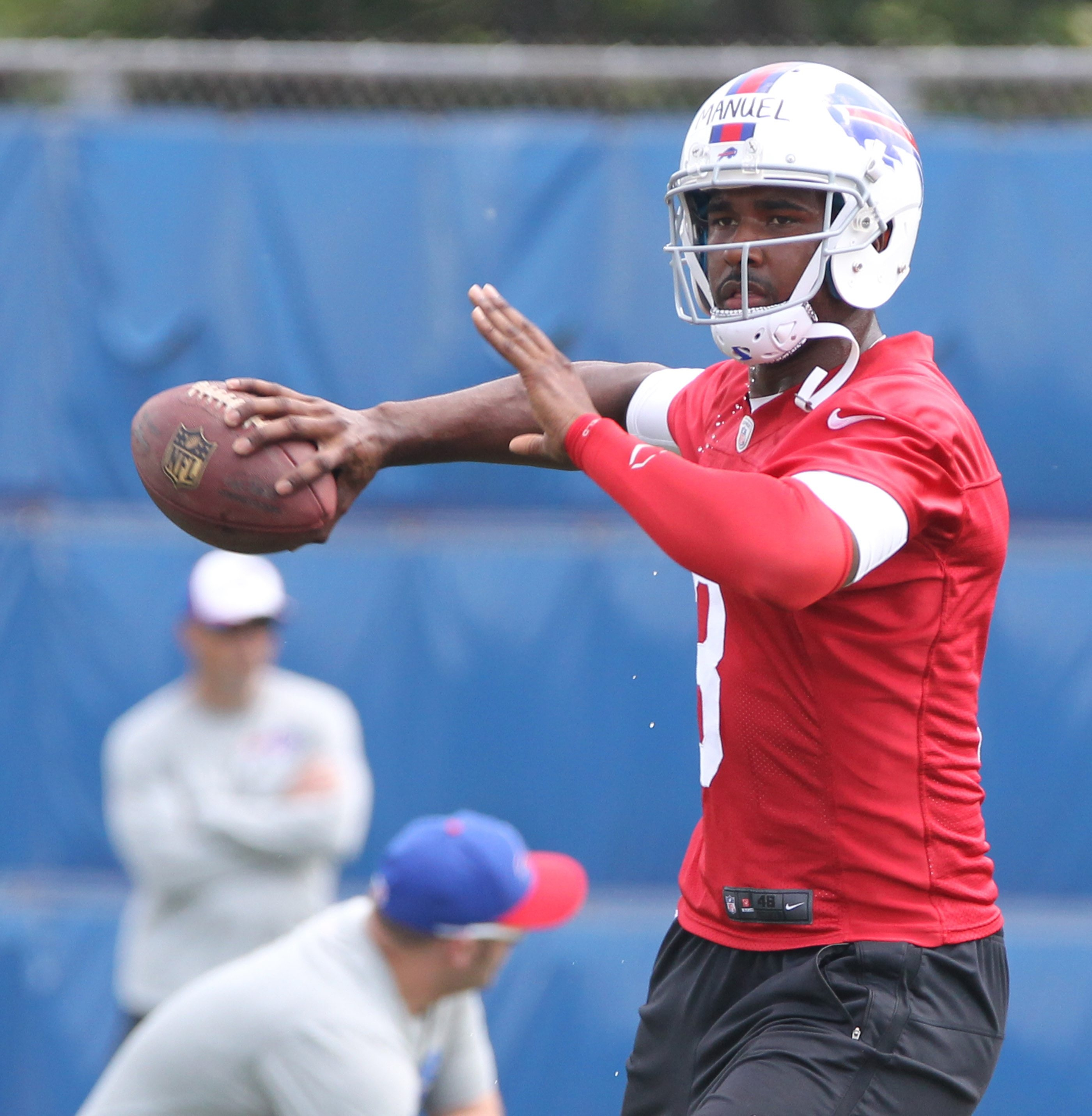 Bills quarterback EJ Manuel (3) runs a drill Tuesday in the team's first day of mandatory minicamp.