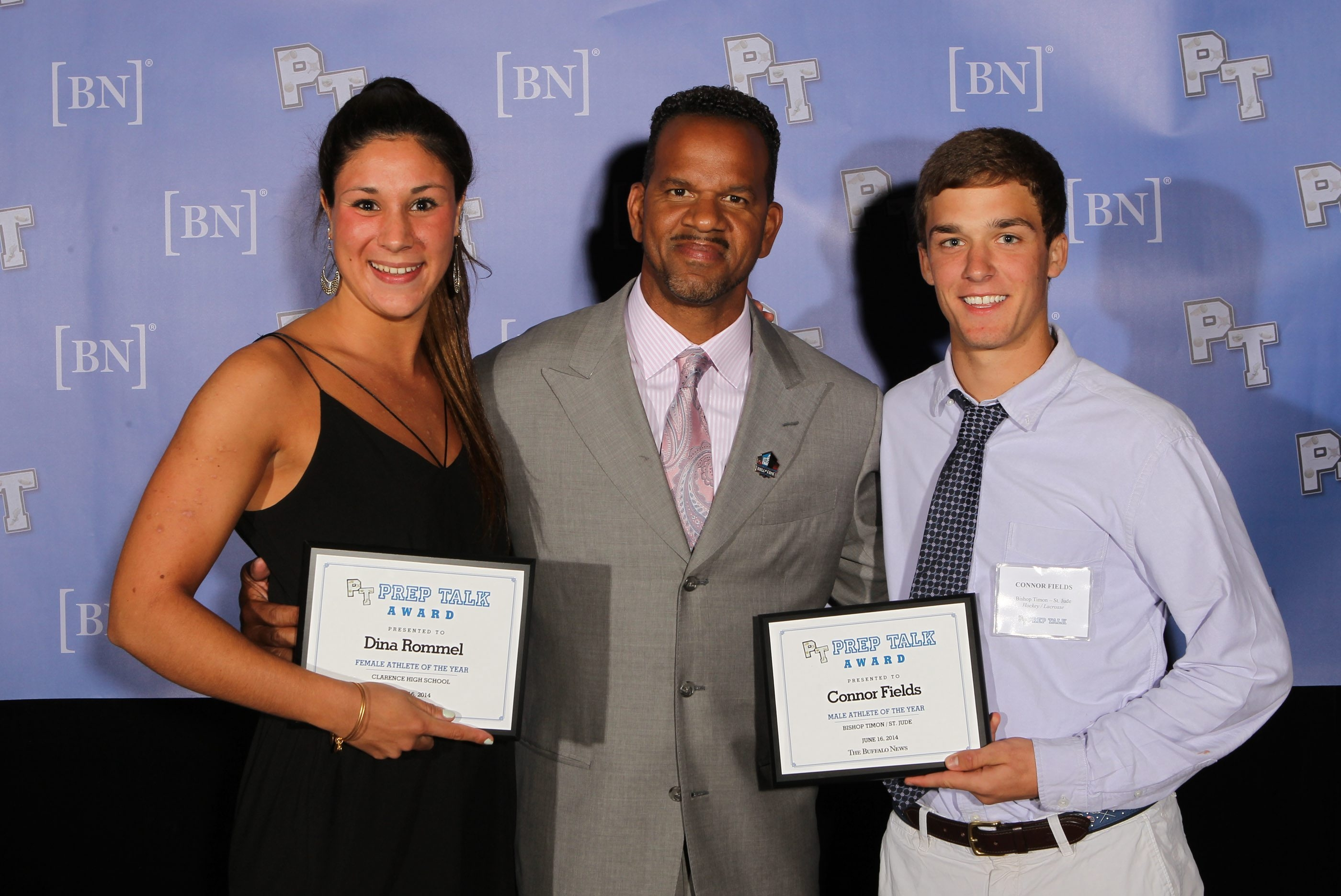 Female and male athletes of the year Dina Rommell of Clarence and Connor Fields of Bishop Timon-St. Jude pose with their awards with Buffalo Bills great Andre Reed.