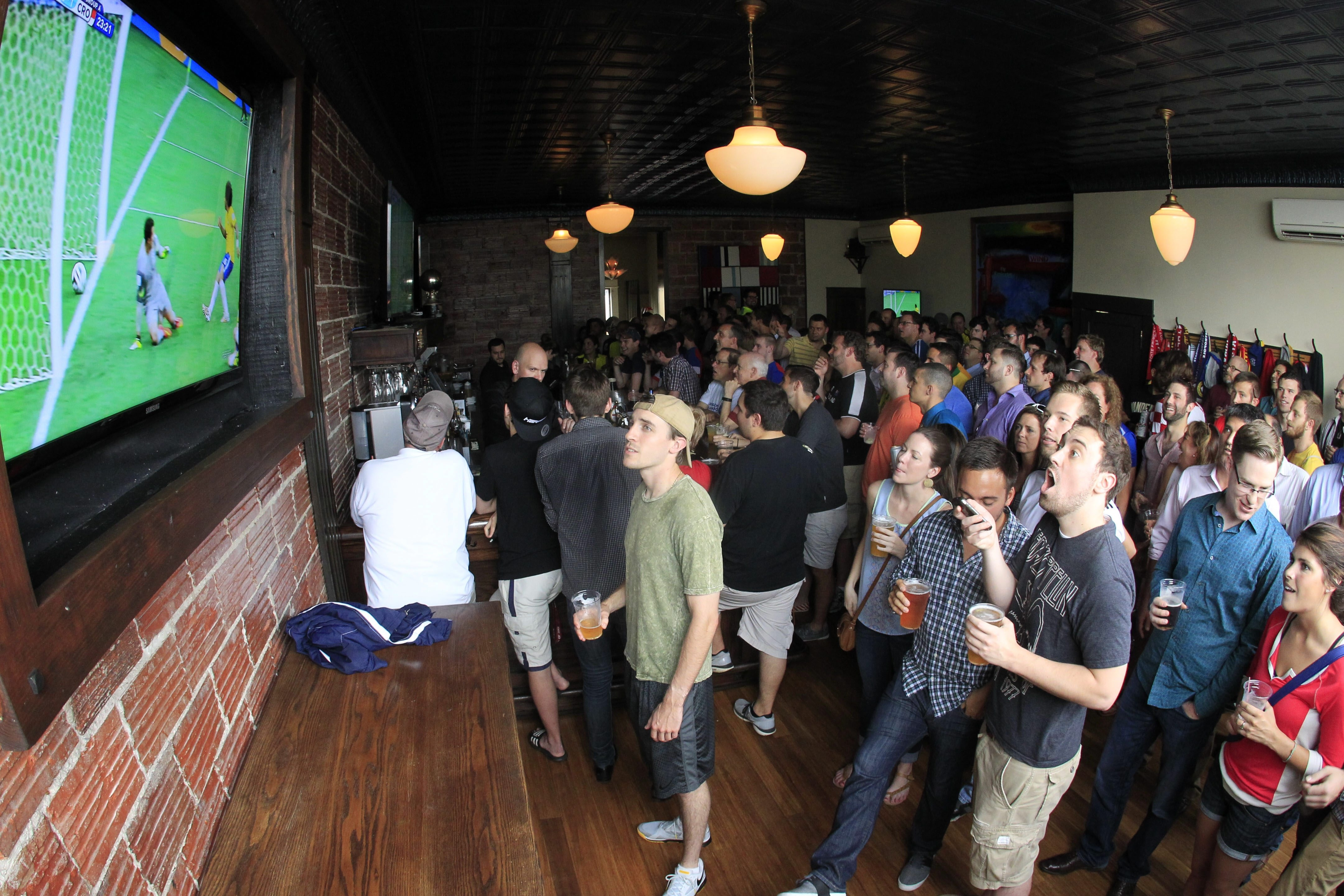 Soccer fans watch a World Cup game at Mes Que on Hertel Avenue Thursday. The bar has become a popular spot for major soccer action.