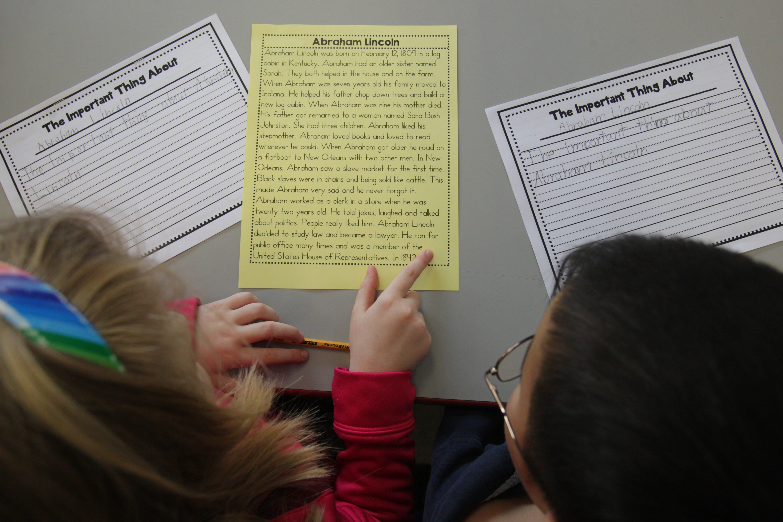 Second graders work on a common core exercise involving President's Day.  (Sharon Cantillon/Buffalo News)