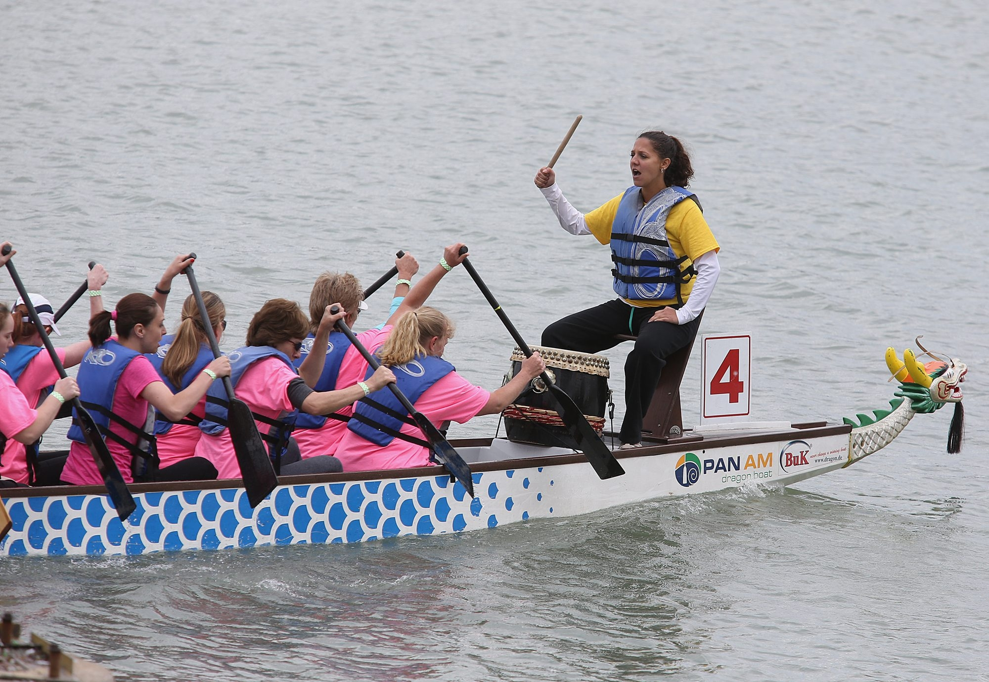 A dragon boat drummer motivates her crew Saturday while racing on Lake LaSalle on the University at Buffalo's North Campus in Amherst during the Hope Chest Buffalo Niagara Dragon Boat Festival.
