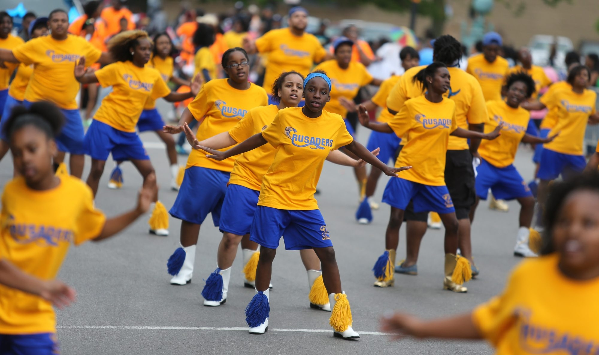 Members of the Crusaders Drill Team perform on Genesee Street in the annual parade to kick off the Juneteenth Festival in Buffalo on Saturday.