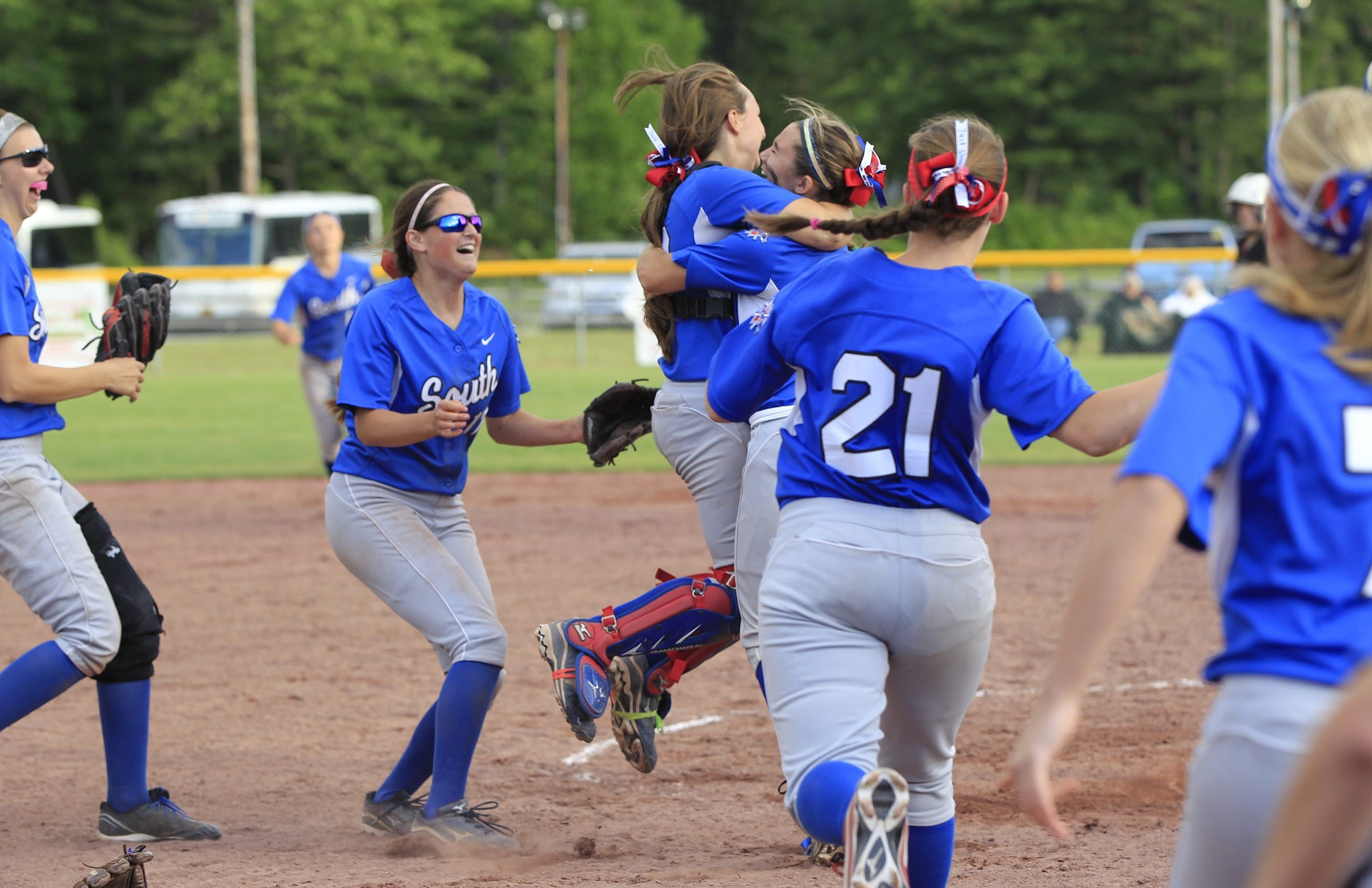Williamsville South players celebrate their 21-4 victory over Sayville in the New York State Class A softball final Saturday.