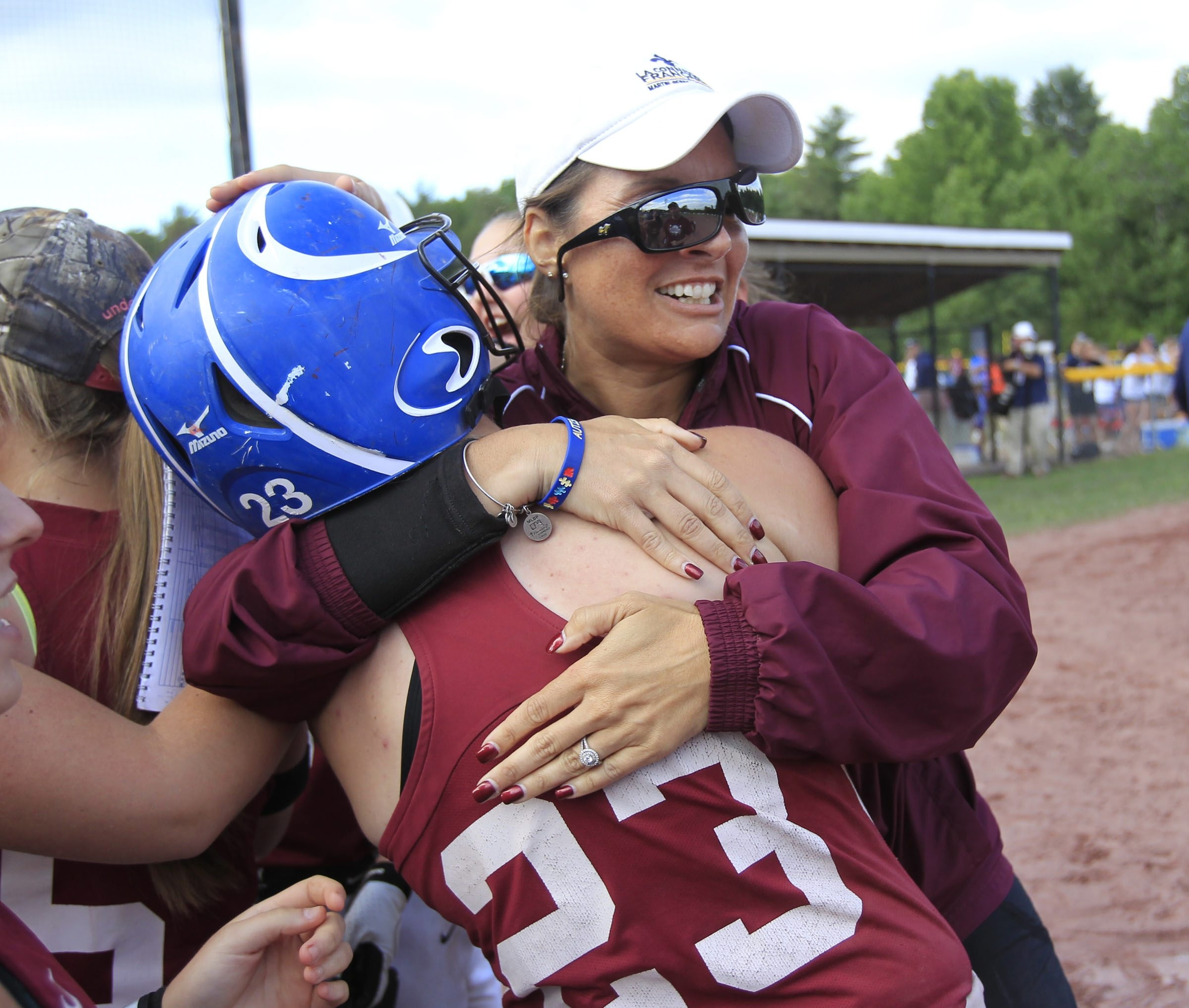 Eden coach Marisa Fallacaro hugs Hayley Kobie after her game-winning hit.