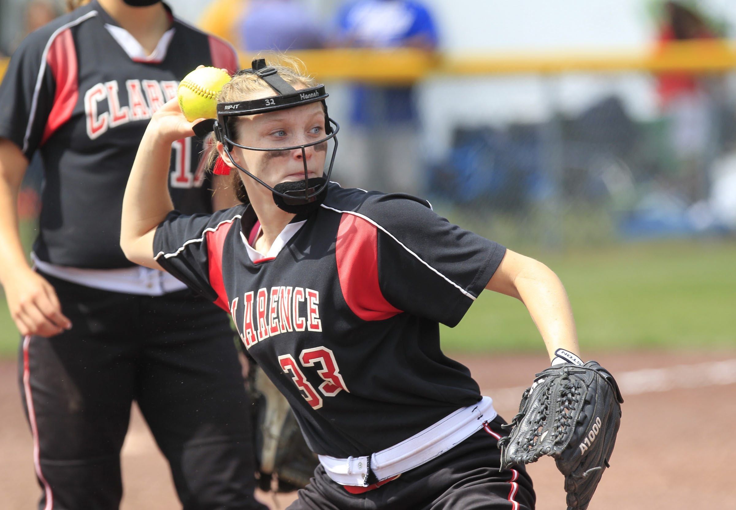Clarence's Hannah Marlowe throws out an East Meadow runner in Saturday's Class AA semifinals.