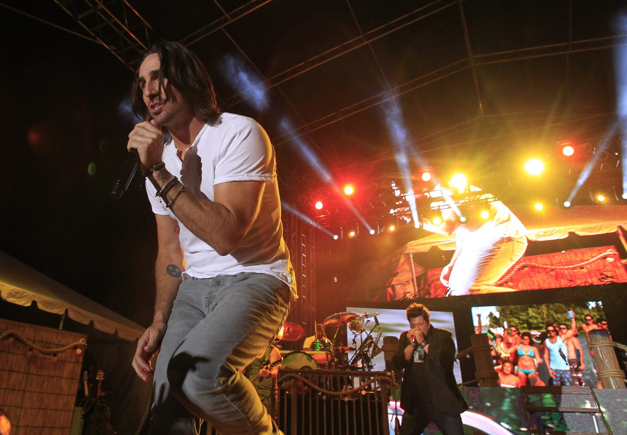 Headliner Jake Owen, top, performs at Taste of Country on Friday at Coca-Cola Field. Above left, Eddie Montgomery of Montgomery Gentry sings during that band's set; fans, center, watch the show; and Jaren Johnston, singer and guitarist of the Cadillac Three performs.