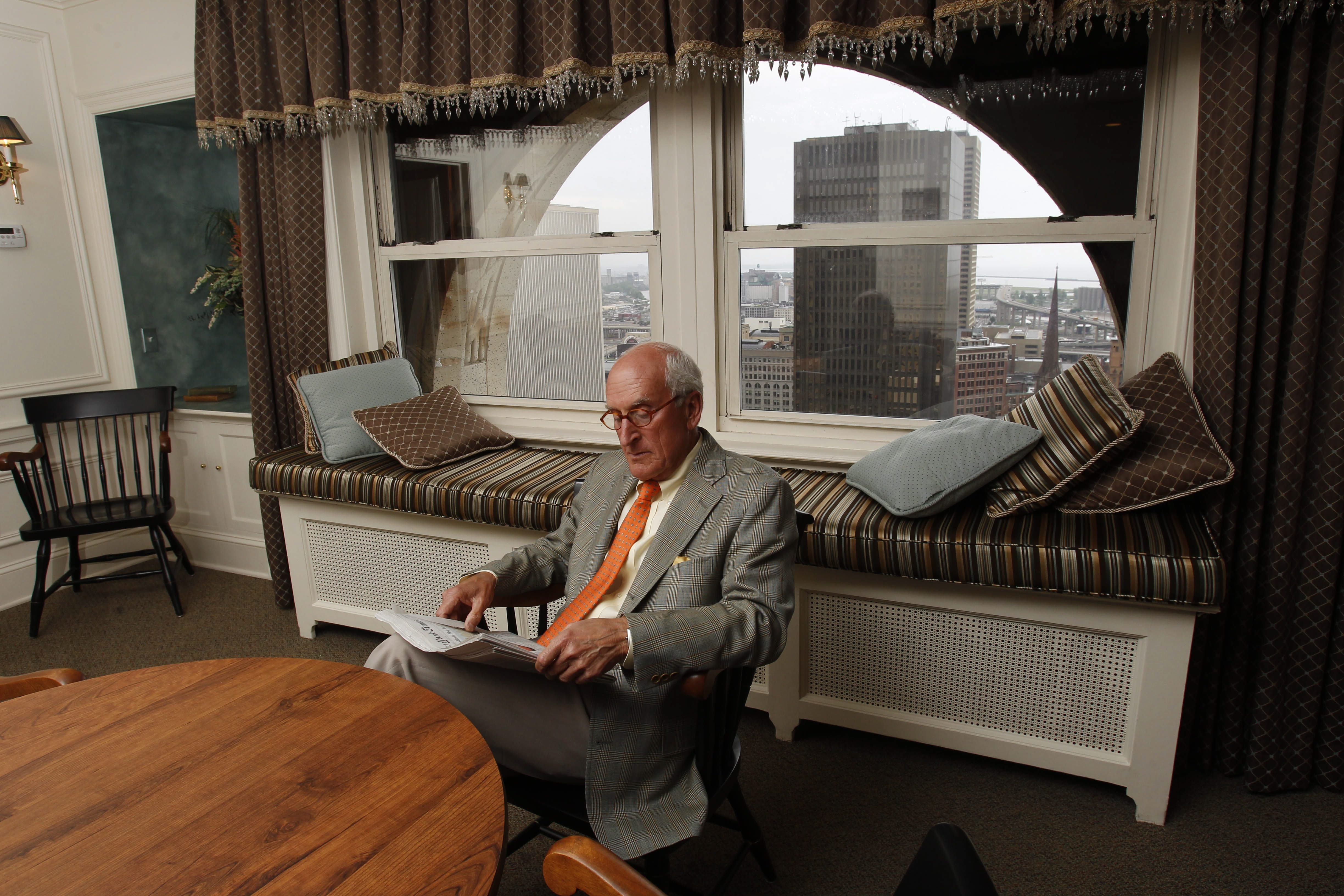 At top, Robert P. Fine, a member of the Mid-Day Club for 30 years, waits for his partner on Friday. Above left, members have their meal on the top floor of the Liberty Building. At right, the long hallway to the lounge.