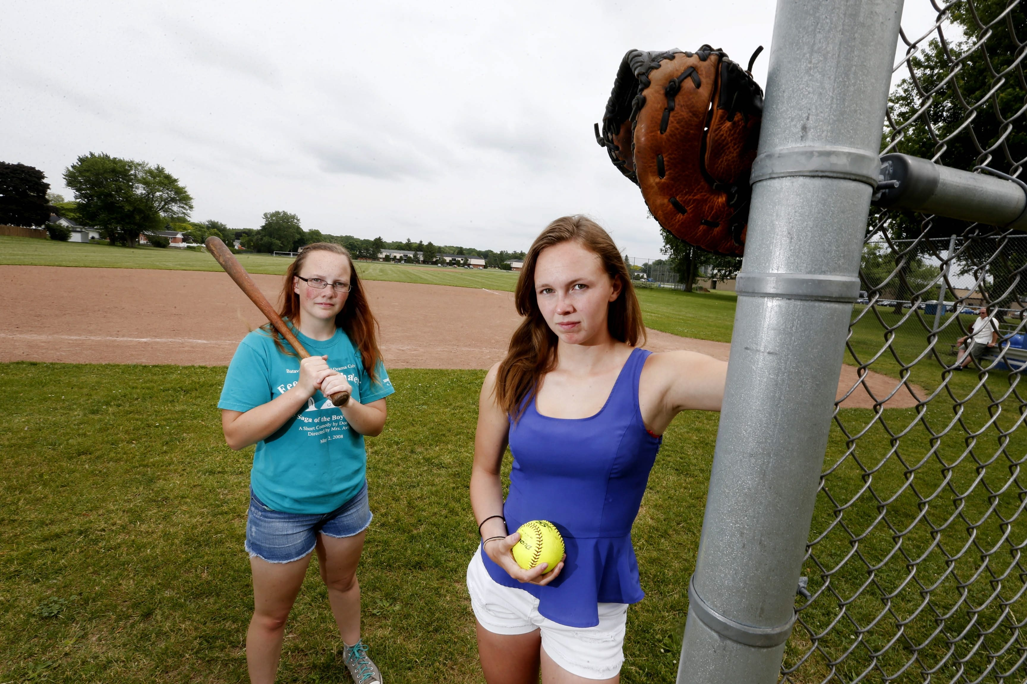 Elizabeth Myers, 18, right, and her sister, Rebecca, 15, visit their softball field. The Myerses  and a third  Batavia varsity softball player sued the school district in federal court and won the right to have access to the same quality athletic facilities as boys have.