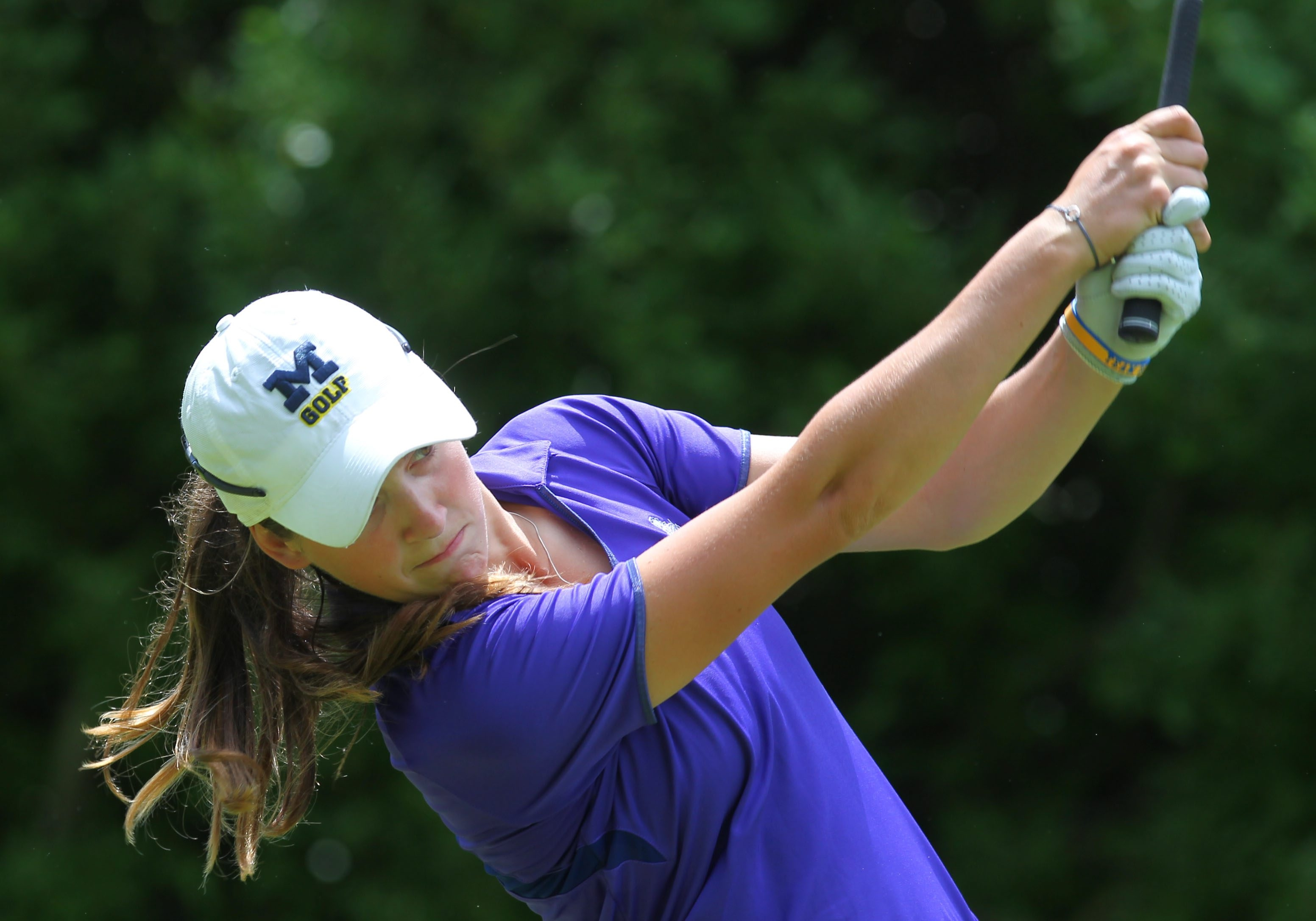 Catherine Peters of Clarence Center watches her tee shot on the par 3 18th during the first round of the Women's Porter Cup at Niagara Falls CC in Lewiston Thursday, June 11, 2014.  (Mark Mulville/Buffalo News)