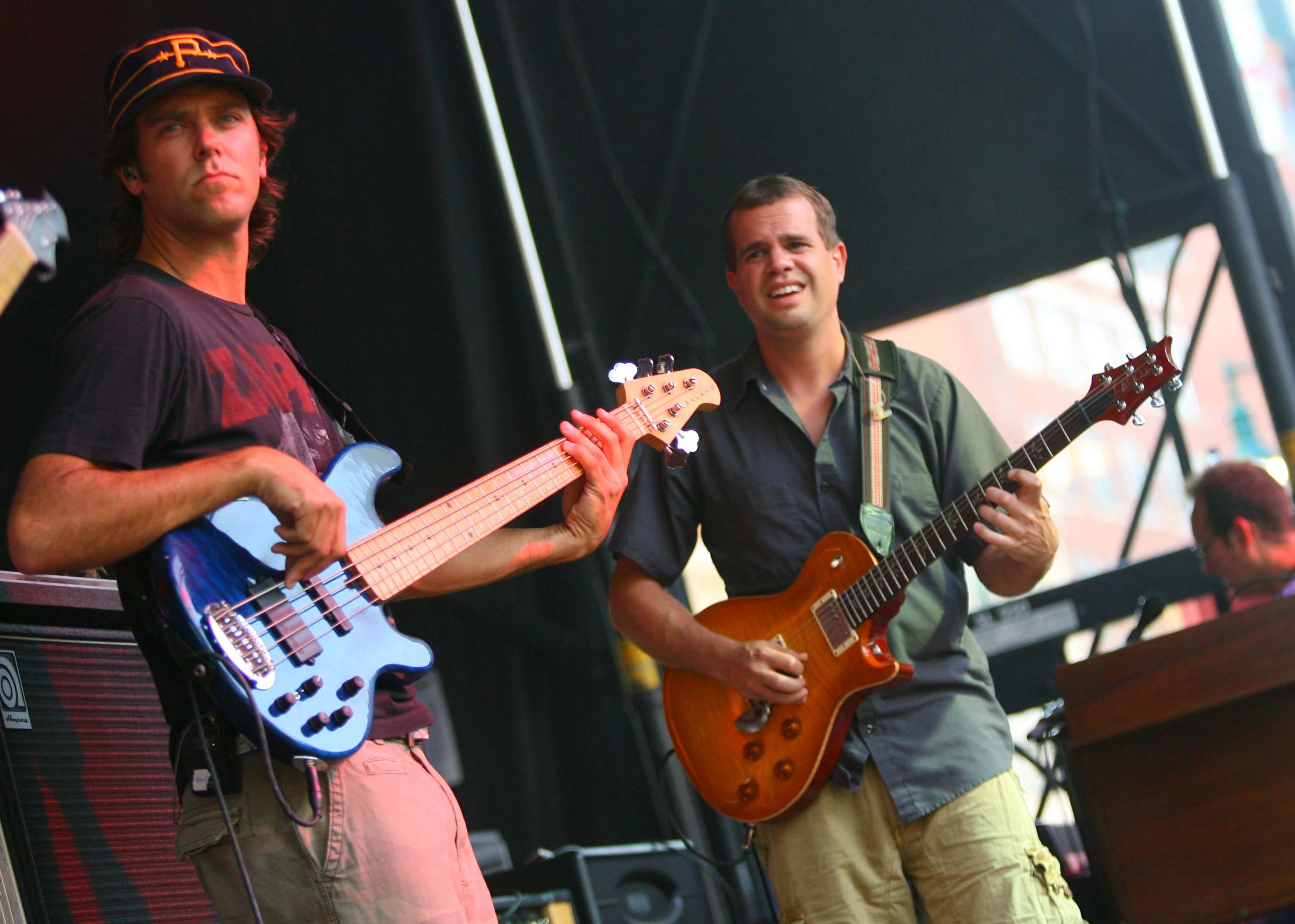 Ryan Stasik, left, plays bass while Brendan Bayliss plays guitar as Umphrey's McGee headlines Thursday at the Square on Thursday, July 15, 2010.{Photo by Bill Wippert}