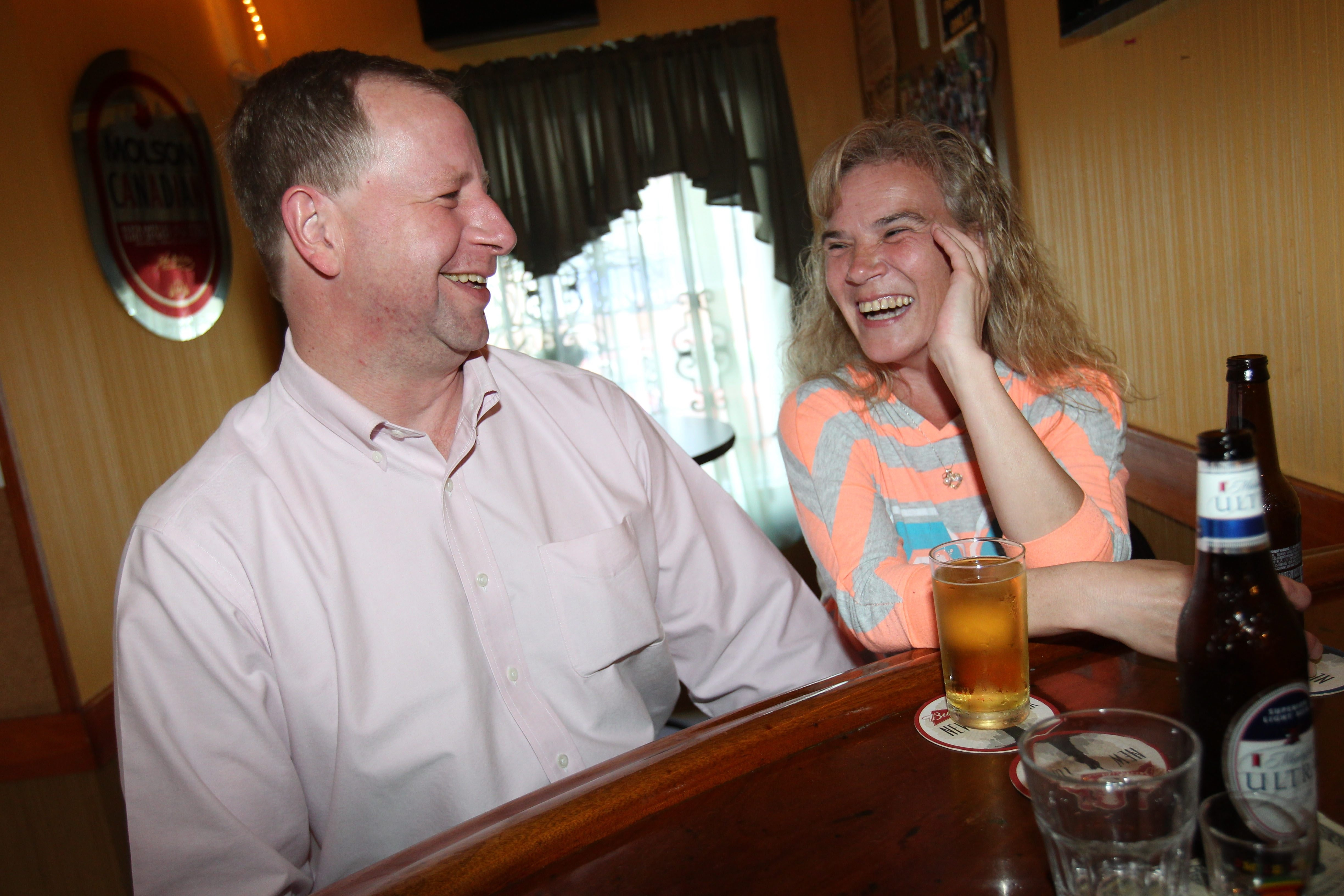 David Stribick and Lynn Giambelluca hang out at the bar at Froggy's Inn on Babcock Street.