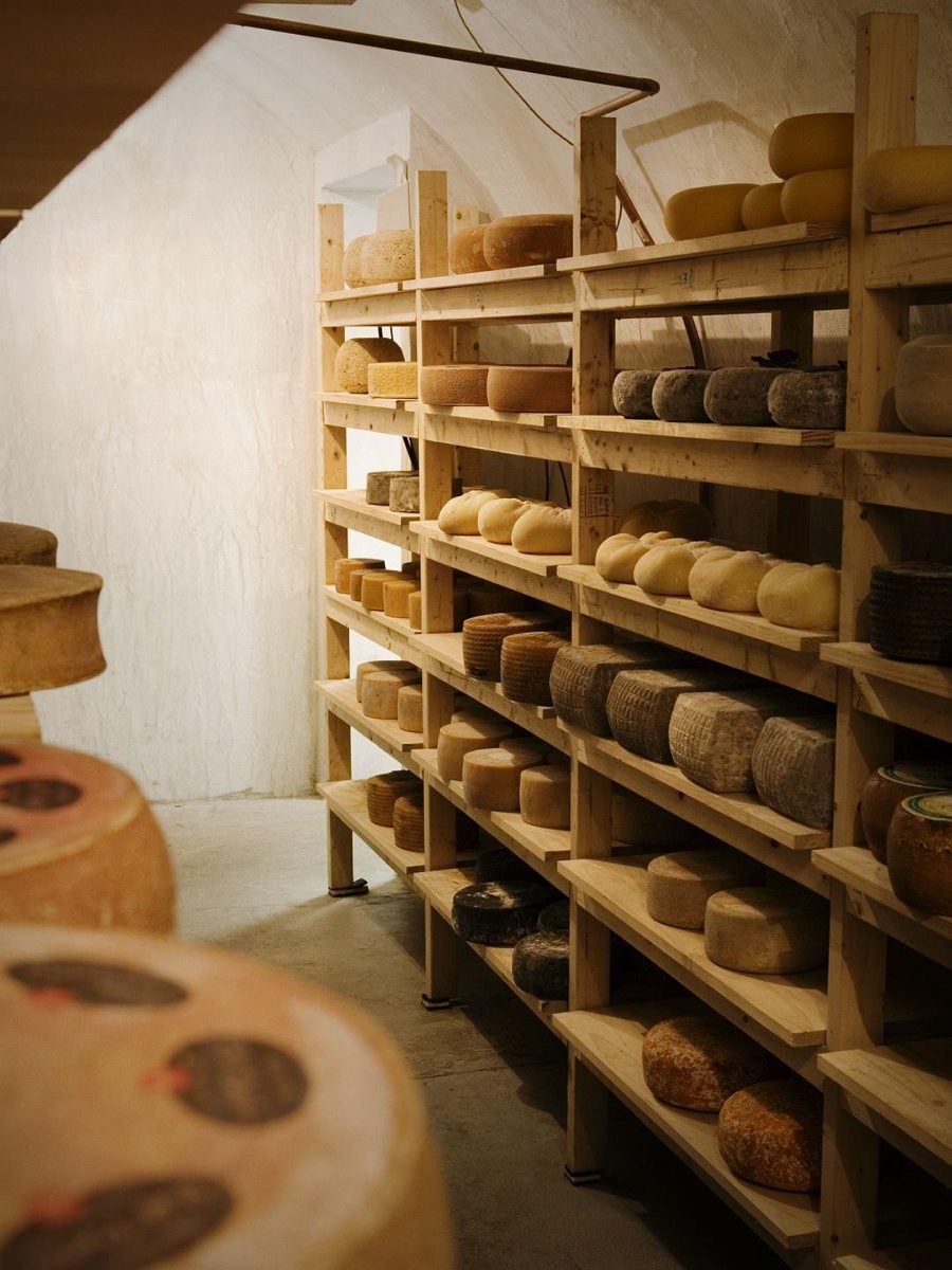 "Cheese ages at Murray's cheese caves in New York City, which were designed by Herve Mons, the leading ""affineur"" of France."