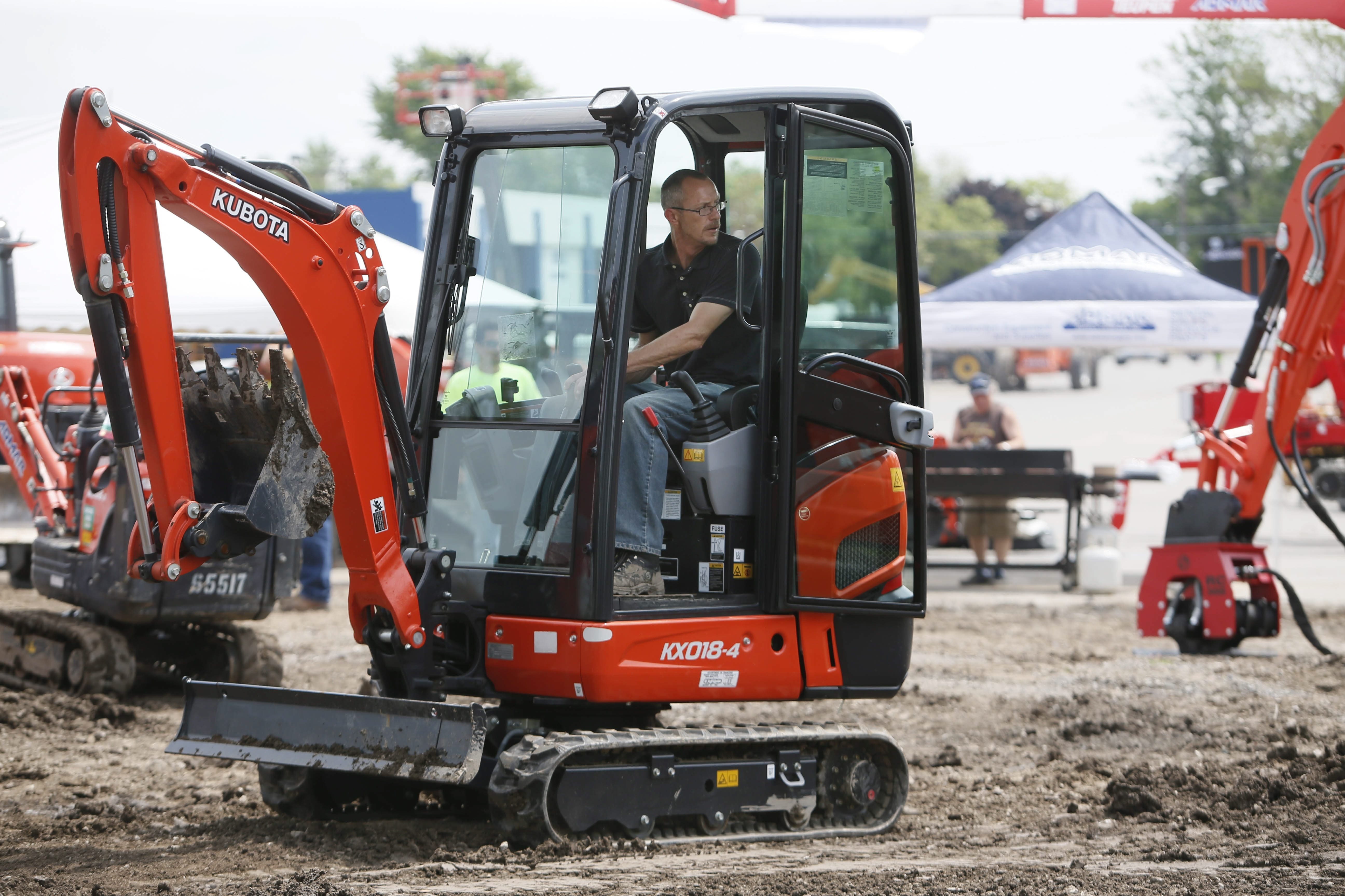 Bob Haley of Alfred State College tries out an excavator during the Admar Spring Construction Expo at Admar Construction Equipment & Supplies in Tonawanda on Tuesday.