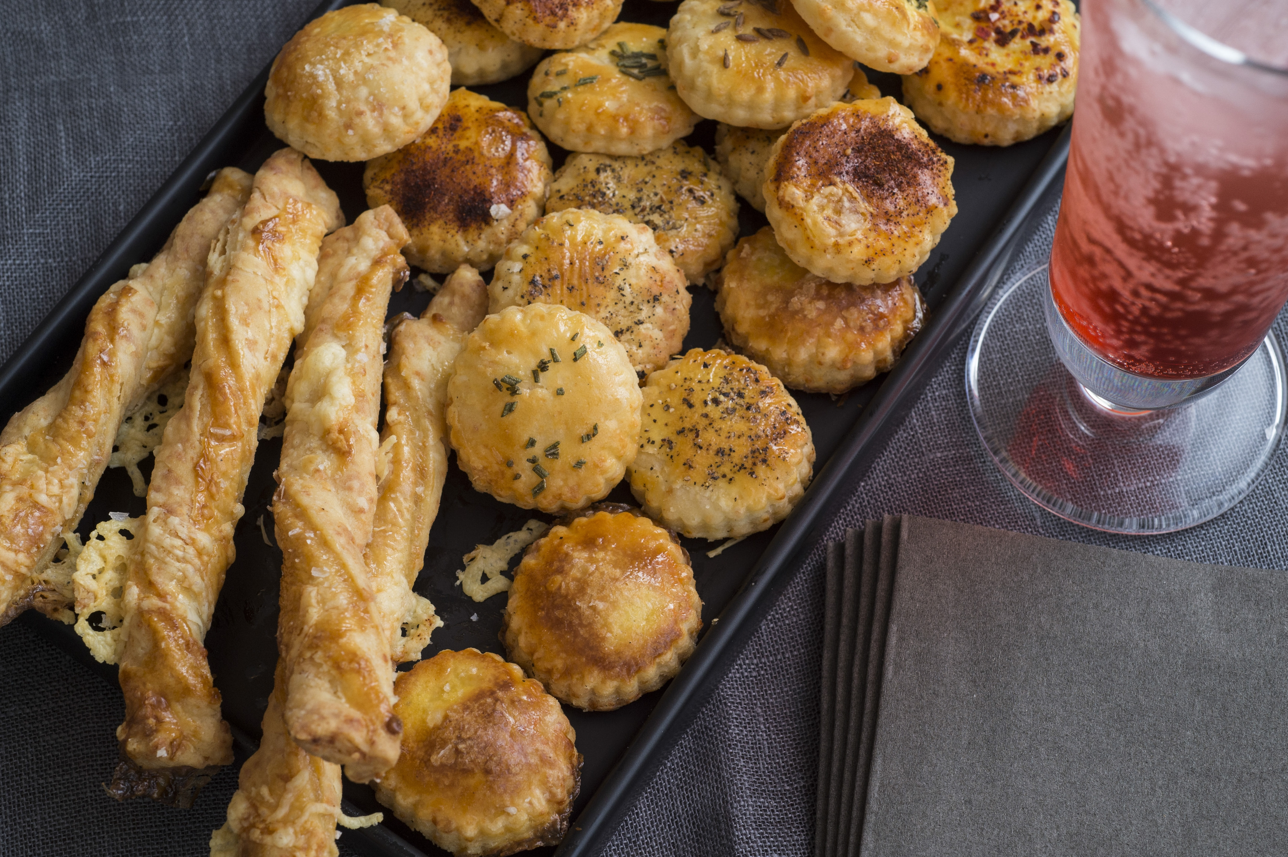 Cheese straws and cheese wafers are easy to prepare as a crispy and salty snack that's sure to please the cocktail crowd.