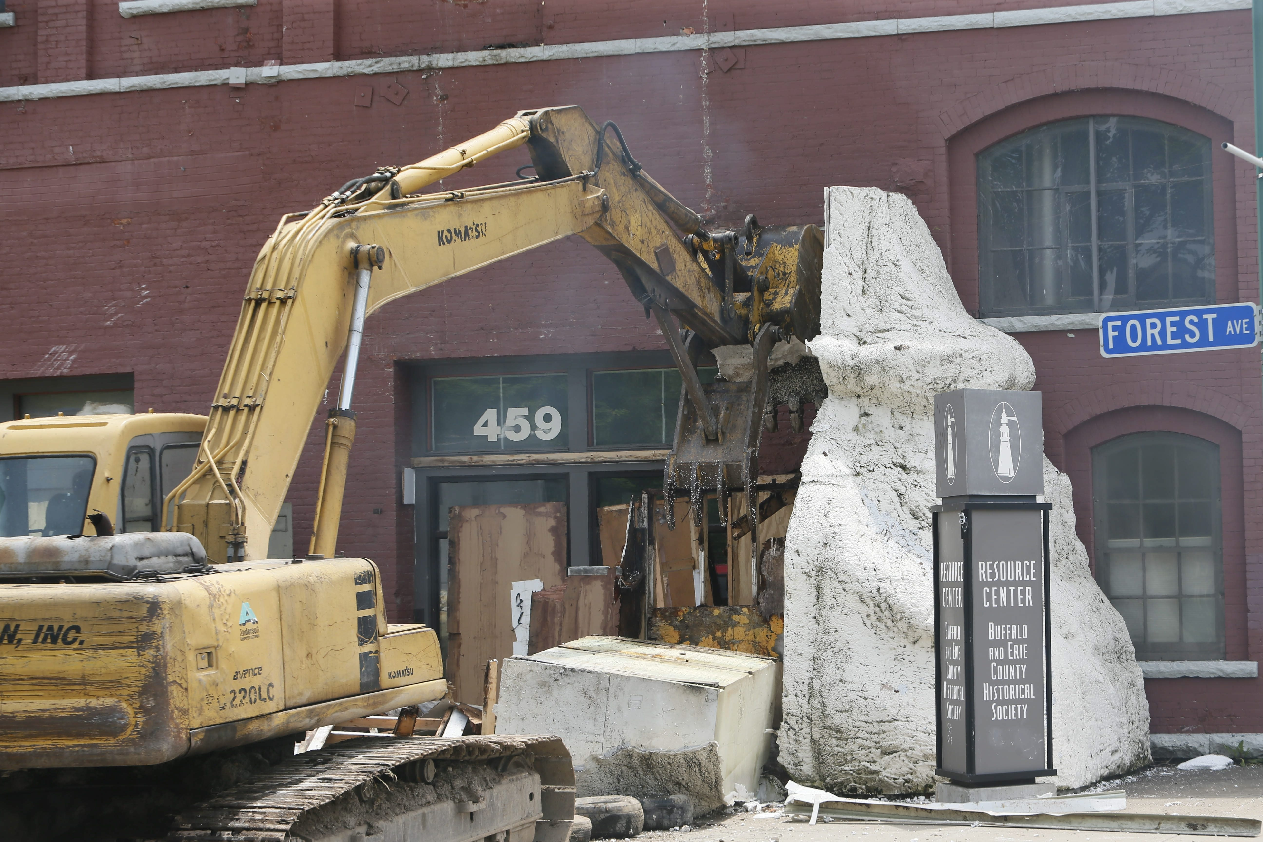 A demolition crew removes the statue from the entrance to the Buffalo History Museum's Resource Center on Forest Avenue on Monday.  The styrofoam replica of a statue from the Pan-American Exhibition was put up in 2001 to mark the centennial of the Pan-Am.