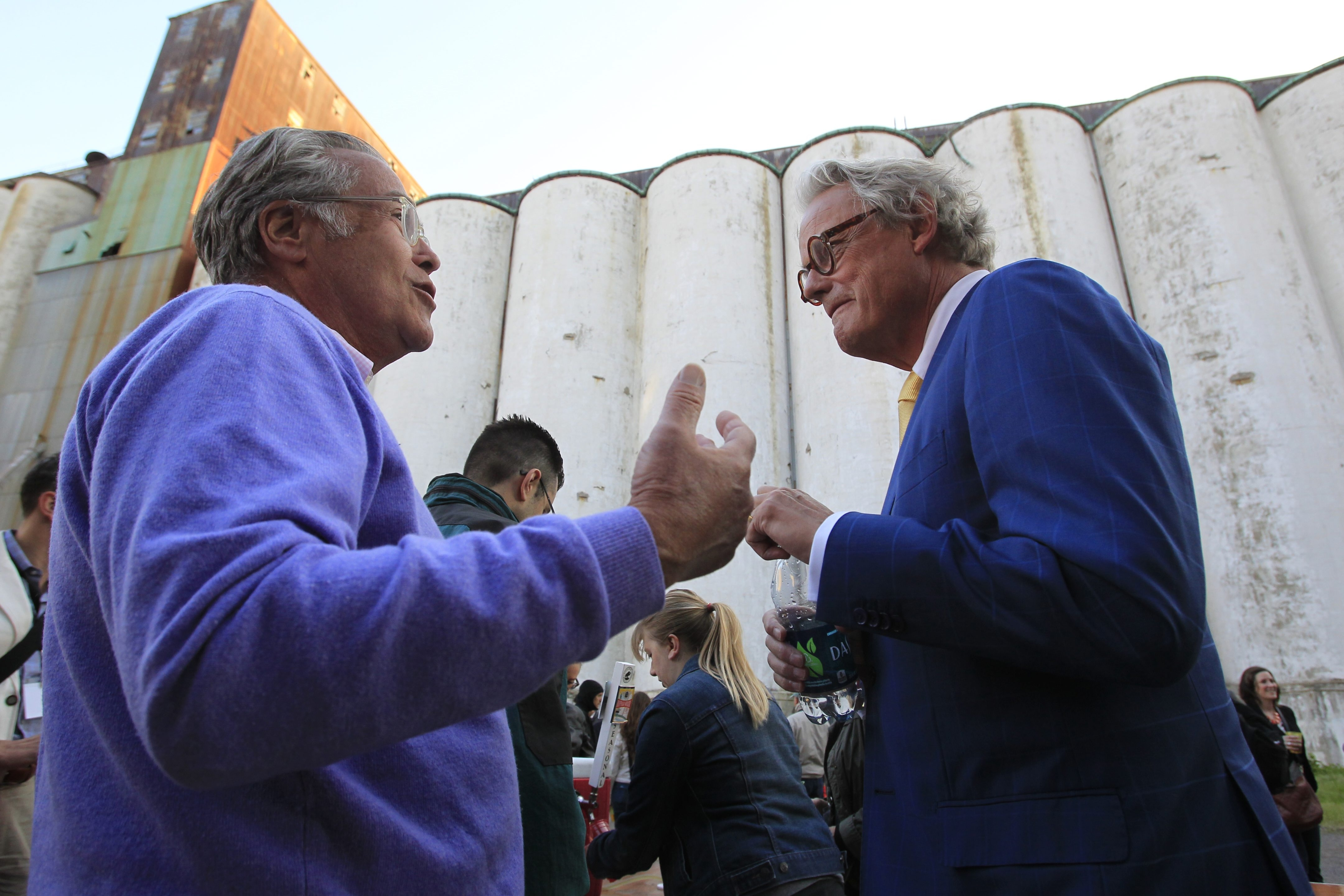 Developer Rocco Termini, left, talks with Sjoerd Soeters during an event hosted by Campaign for Greater Buffalo History, Art and Culture at Silo City on Thursday.