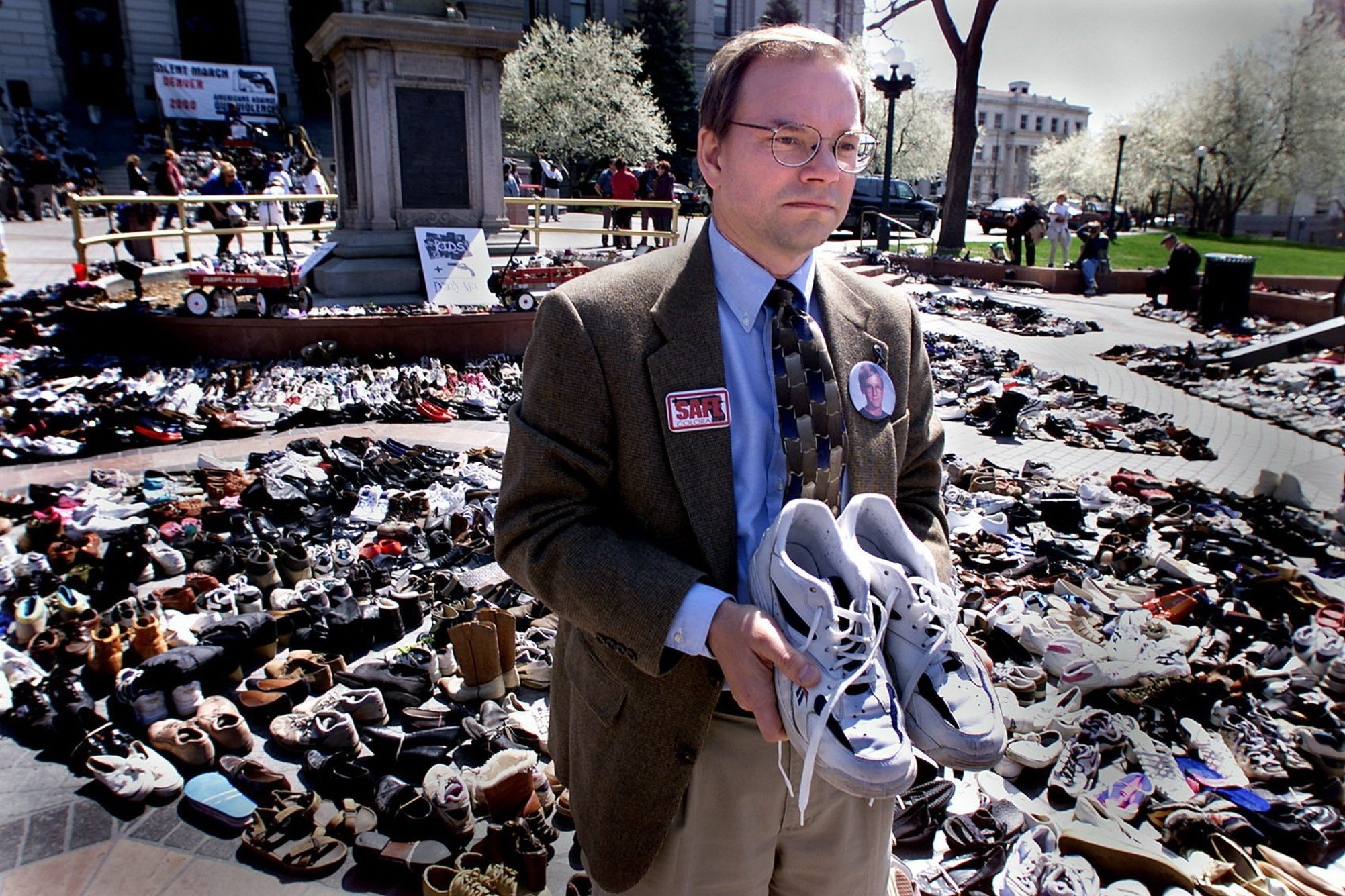 Thomas Mauser, shown holding the shoes of his son, Daniel, who was killed in the school shooting in Columbine, Colo., is hit hard whenever he hears of another mass shooting.