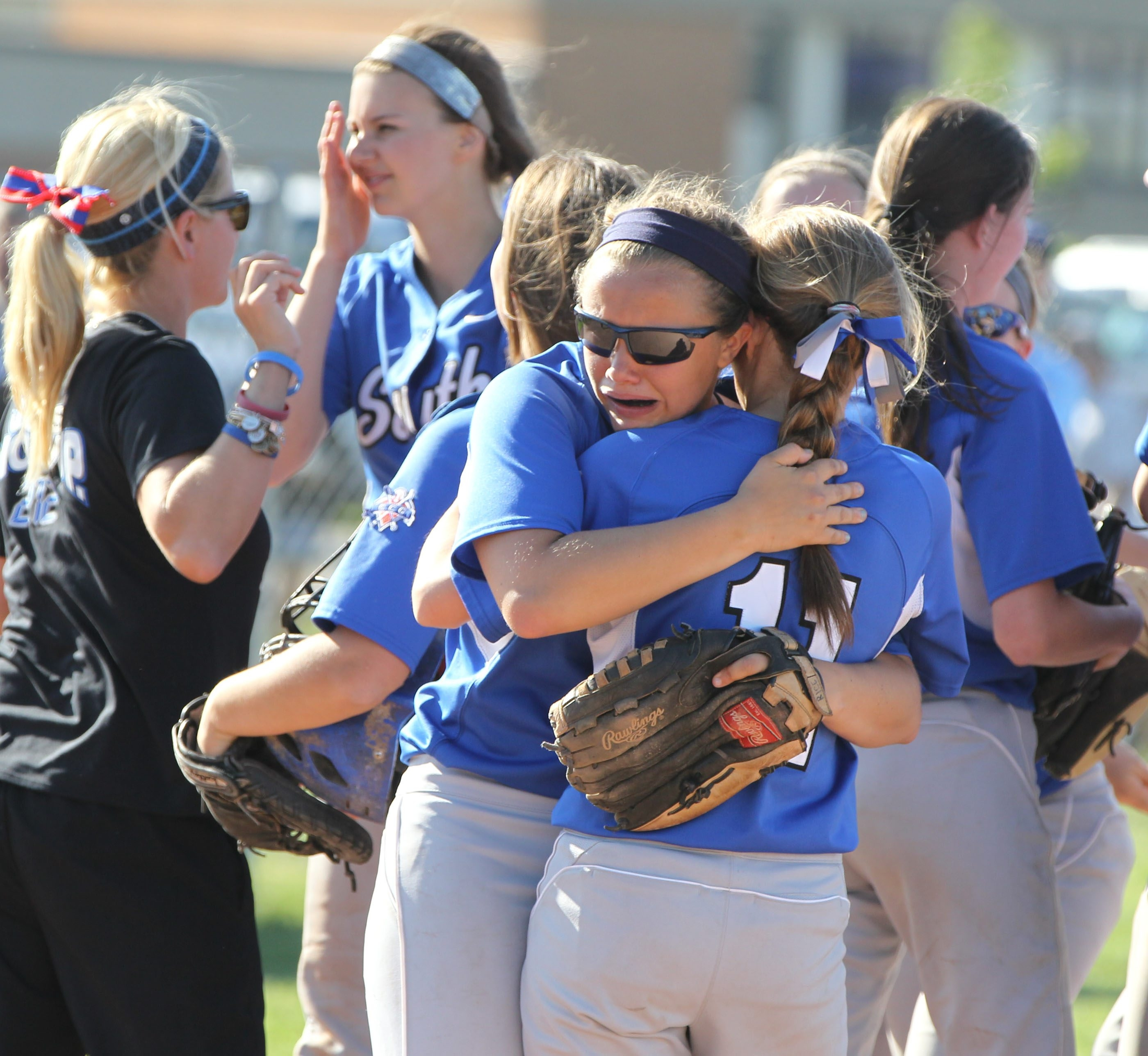 Williamsville South's Nicole Rice embraces teammate Morgan Maley (11) after beating Geneva, 8-7, in extra innings.