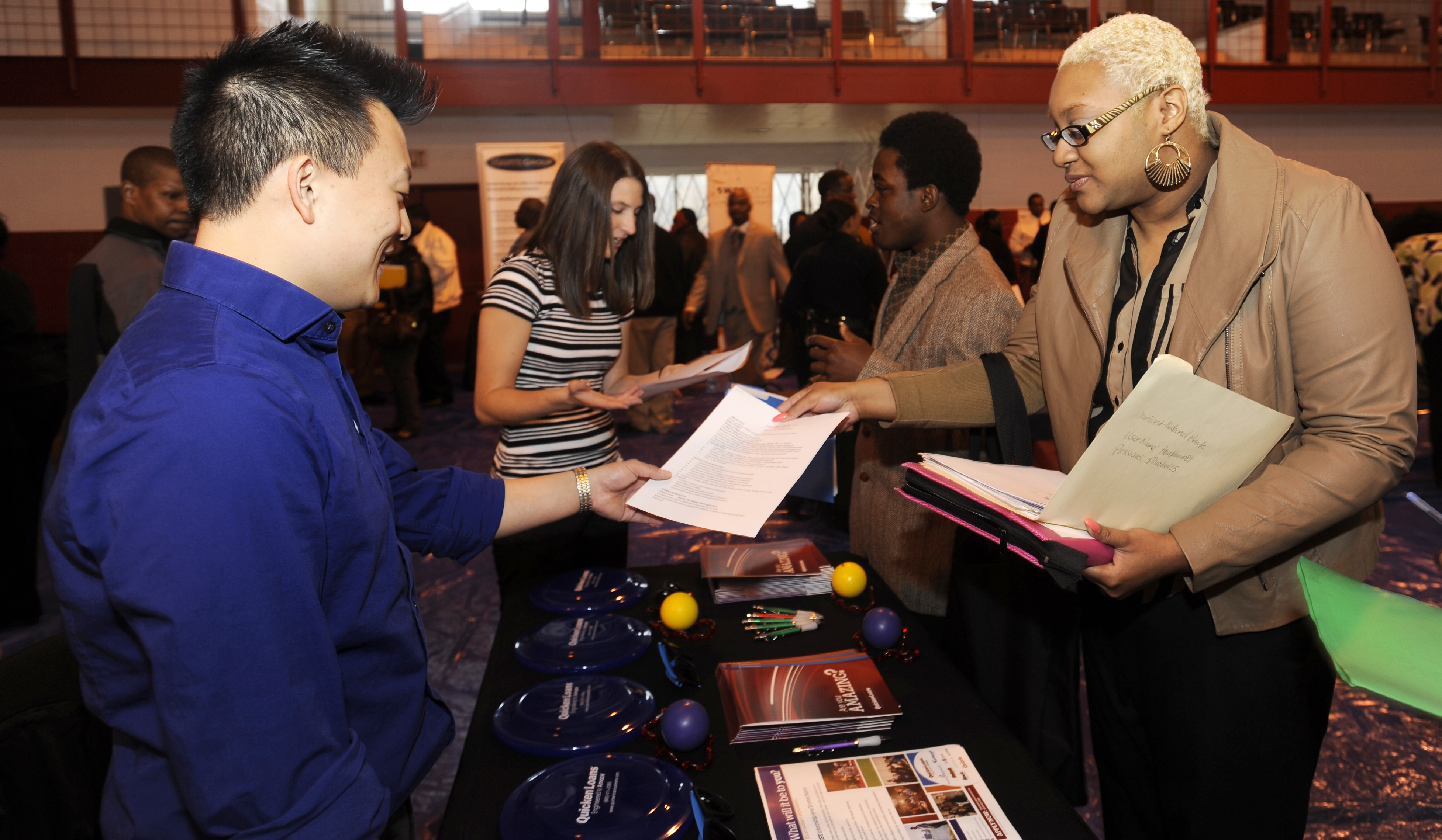 In this April 23, 2014 photo, Luke Gill, of Quicken Loans, left, talks with job candidate Jasmine Boykins at a job fair at the Matrix Center in Detroit. The government issues ist May jobs report on Friday, June 6, 2014. (AP Photo/The Detroit News, David Coates)