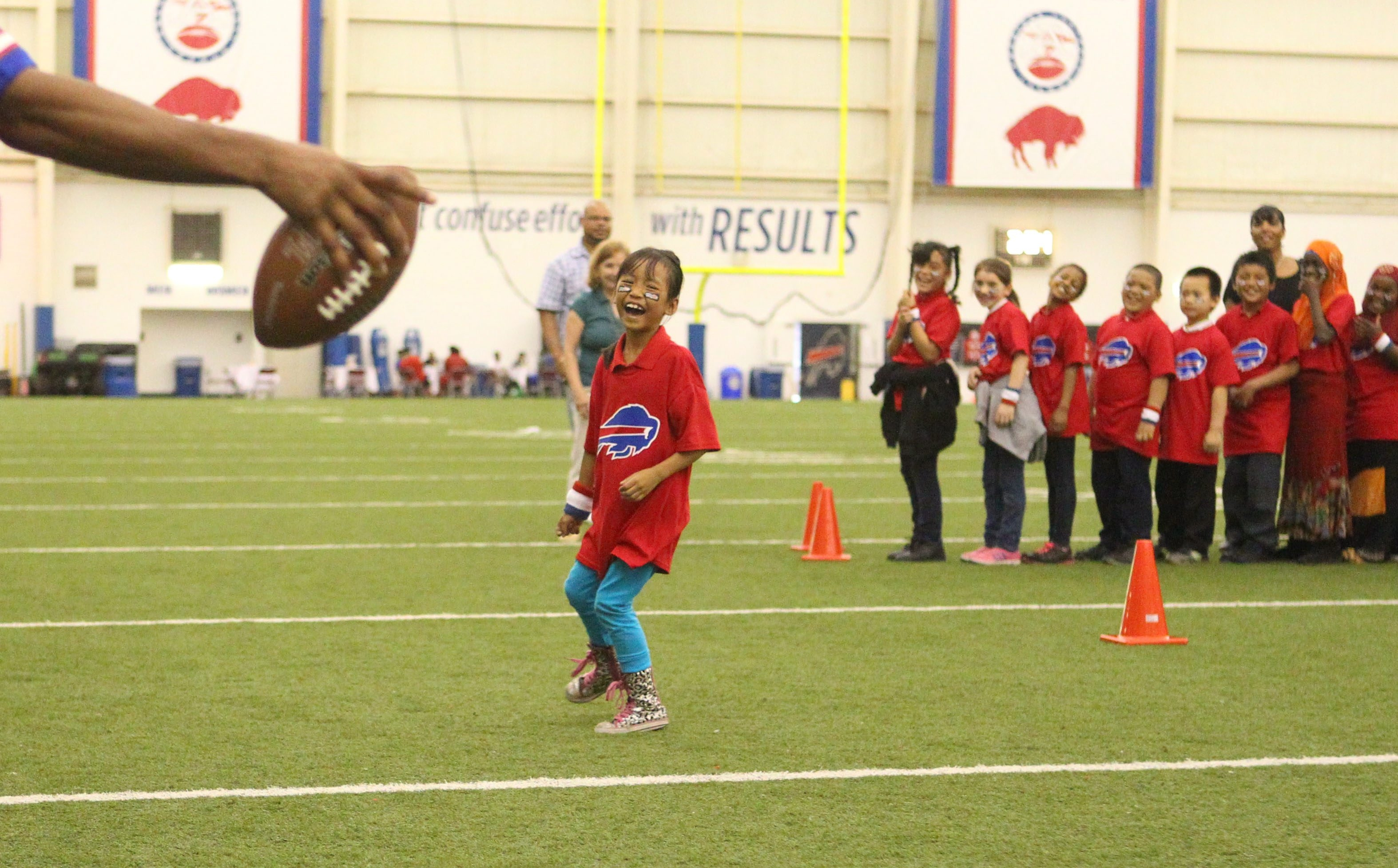 Third-graders from Buffalo Public School No. 18 have some fun running through drills with Buffalo Bills players Tuesday at Ralph C. Wilson Field House in Orchard Park.