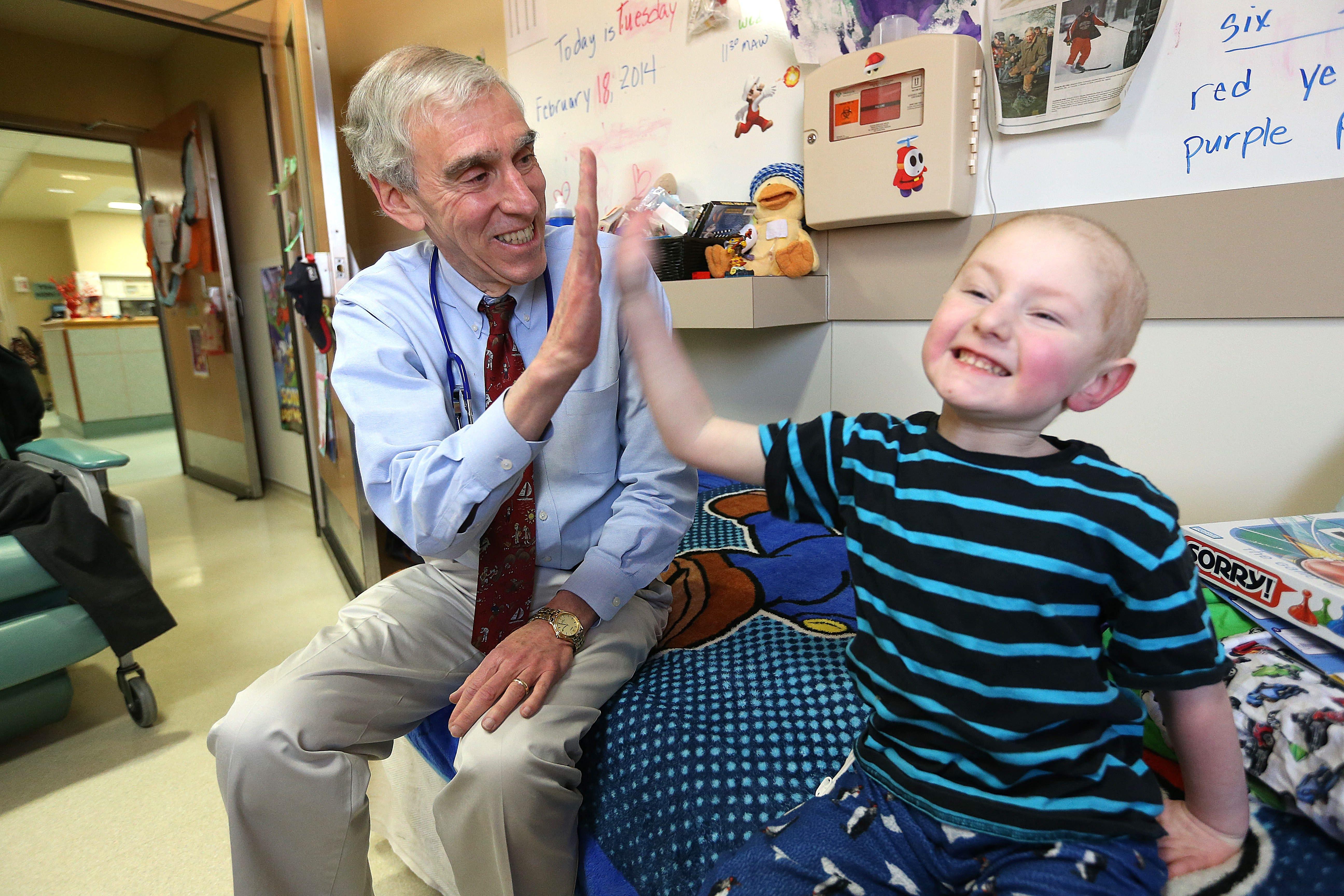 Dr. Martin Brecher and Leukemia patient Brett Struble, 5, of South Dayton, NY, at Roswell on Tuesday, Feb. 18, 2014.  (Robert Kirkham/Buffalo News)