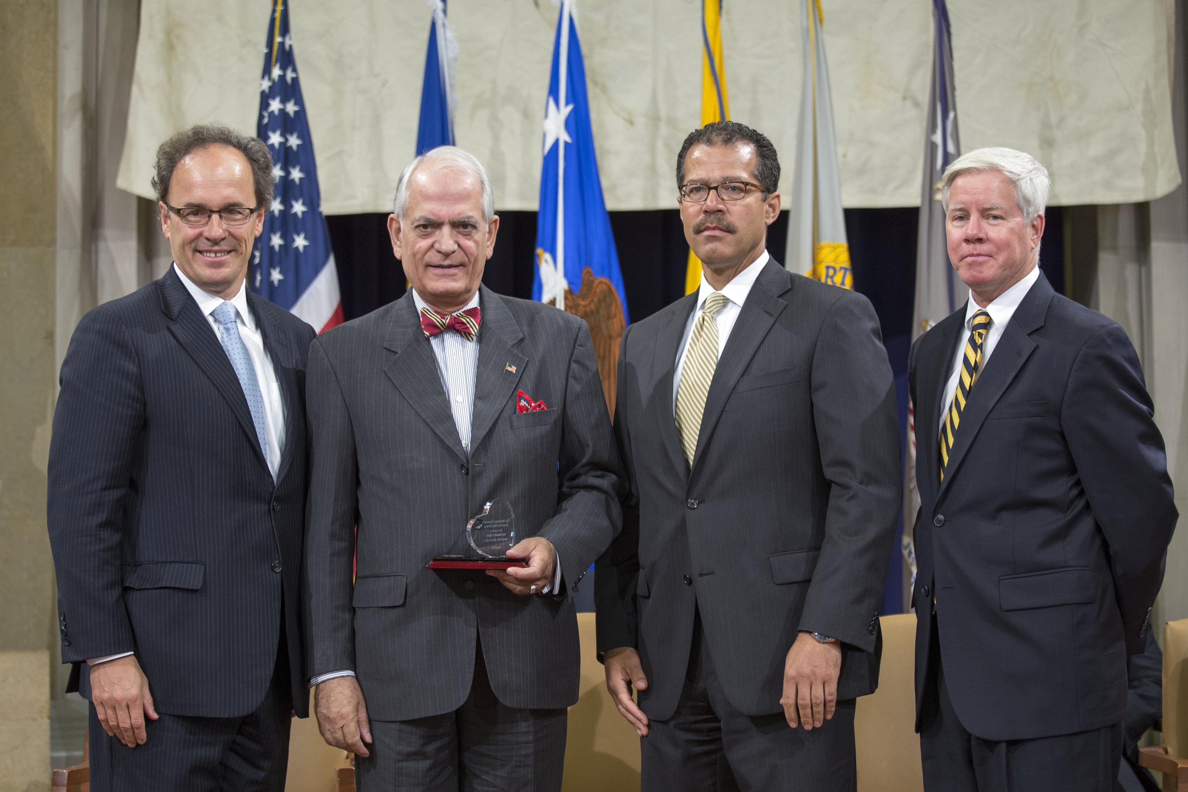 Amherst's Dr. Khalid J. Qazi, second from left, receives Justice Department award. With him are, from left, U.S. Attorney William J. Hochul Jr. and U.S. officials Monty Wilkinson and Lee Lofthus.