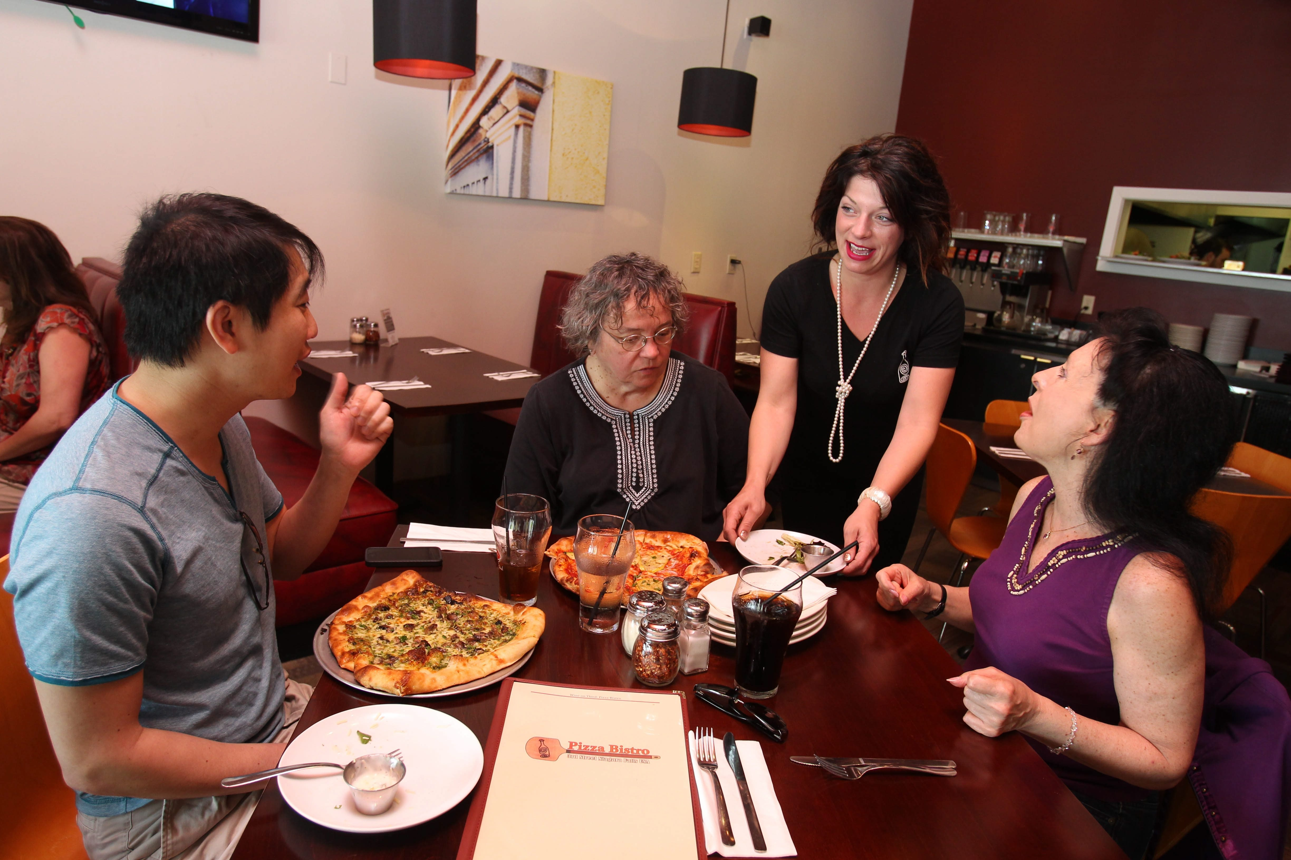 Caroline Boback serves customers at Pizza Bistro on Third Street in Niagara Falls.  Customers, from left, are Chris Yuen of Niagara Falls, Marcia Mitrowski of Buffalo and Marsha Christiano of Amherst.