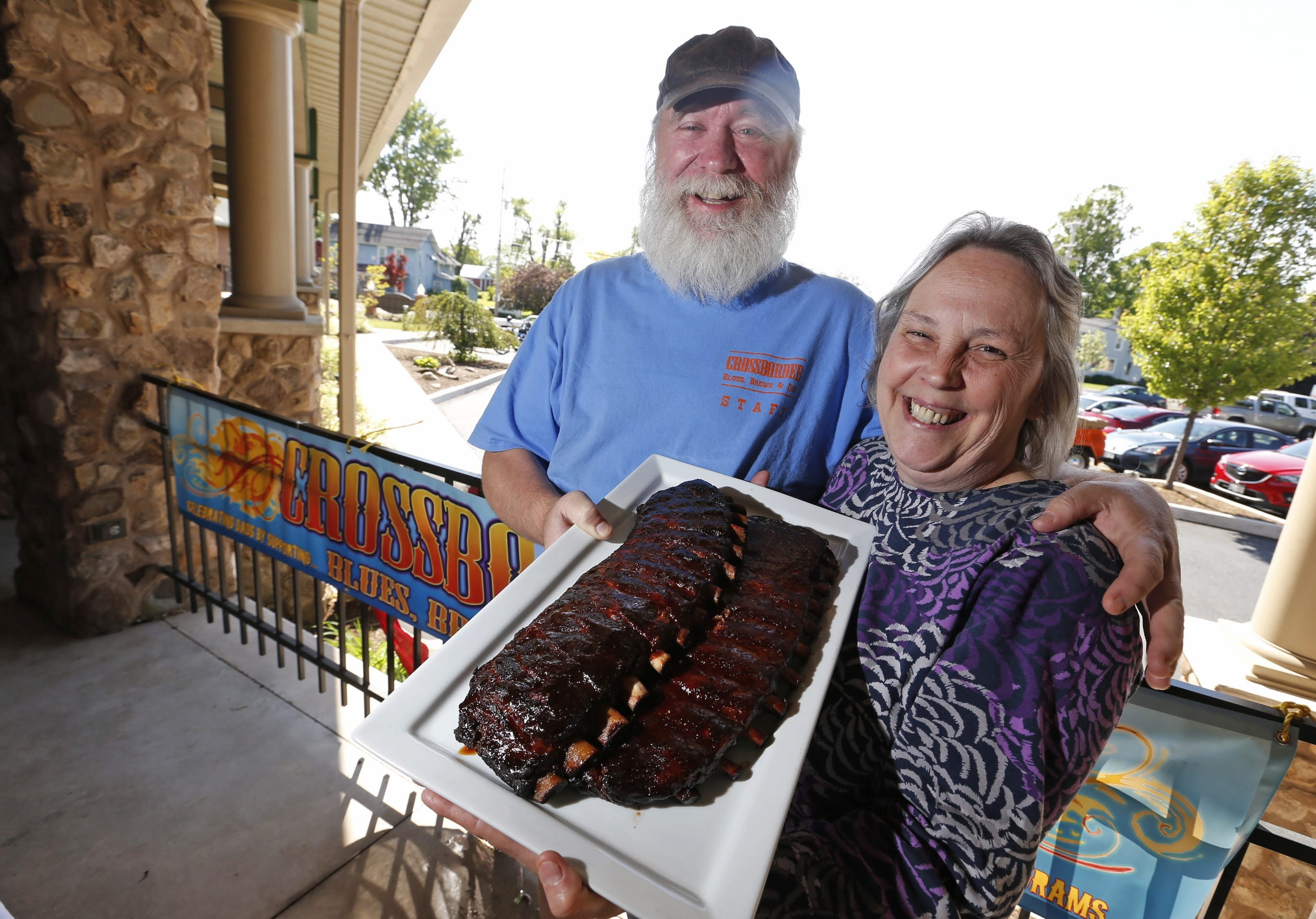 Frank Tutzauer and his wife, Carol, display some of their award-winning ribs. He will head the BBQ portion of Crossborder Blues, Brews and BBQs in Wilson.