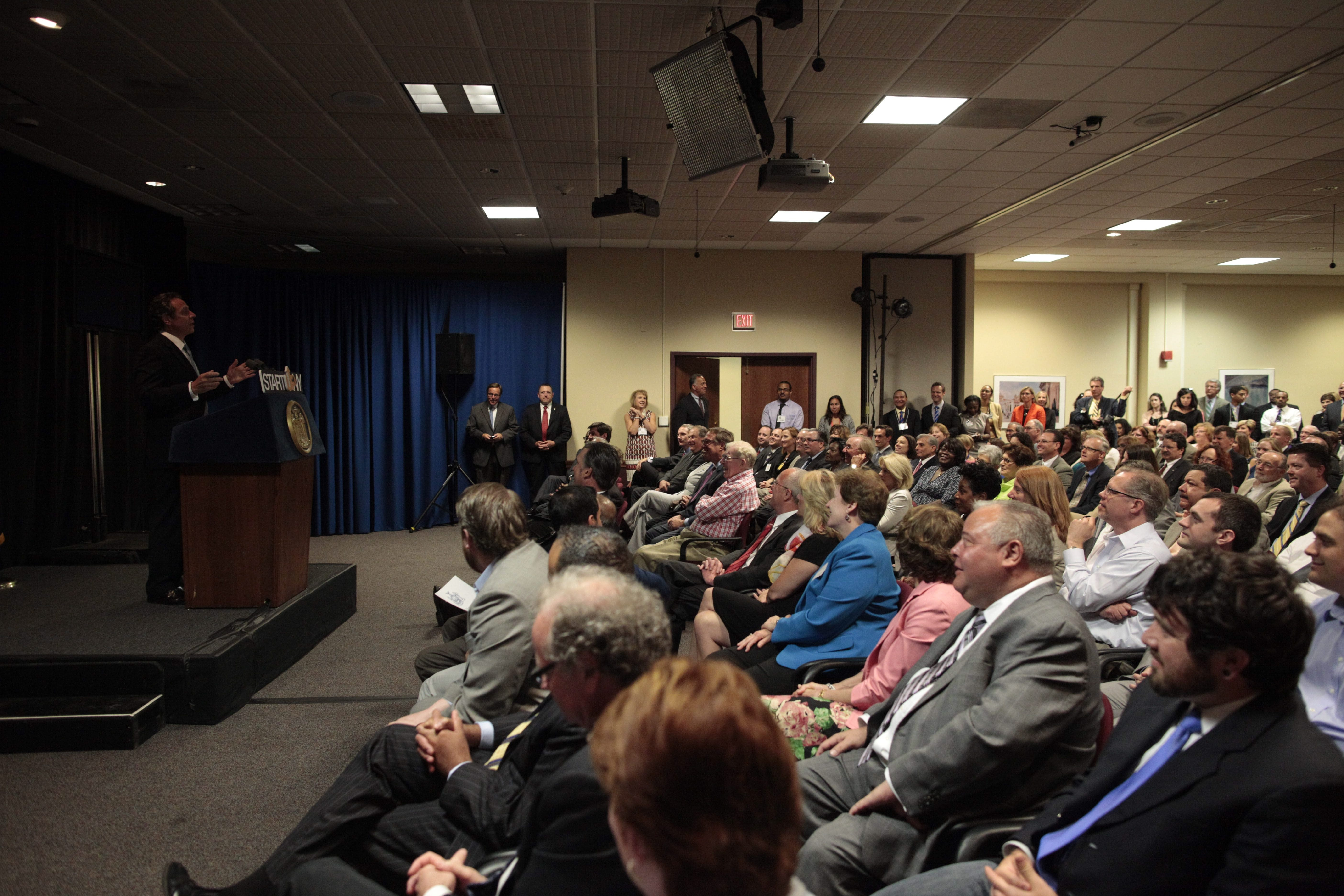 New York Gov. Andrew Cuomo keeps speaking after losing electric power on stage during an event at Roswell Park Cancer Institute, Wednesday, June 4, 2014. (Derek Gee/Buffalo News)