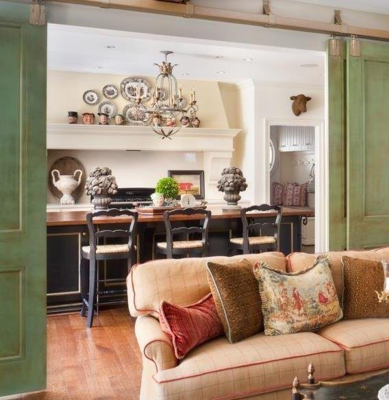 Accessorizing the kitchen island and hanging a collection above the stove are two ways to make your kitchen more visually interesting.