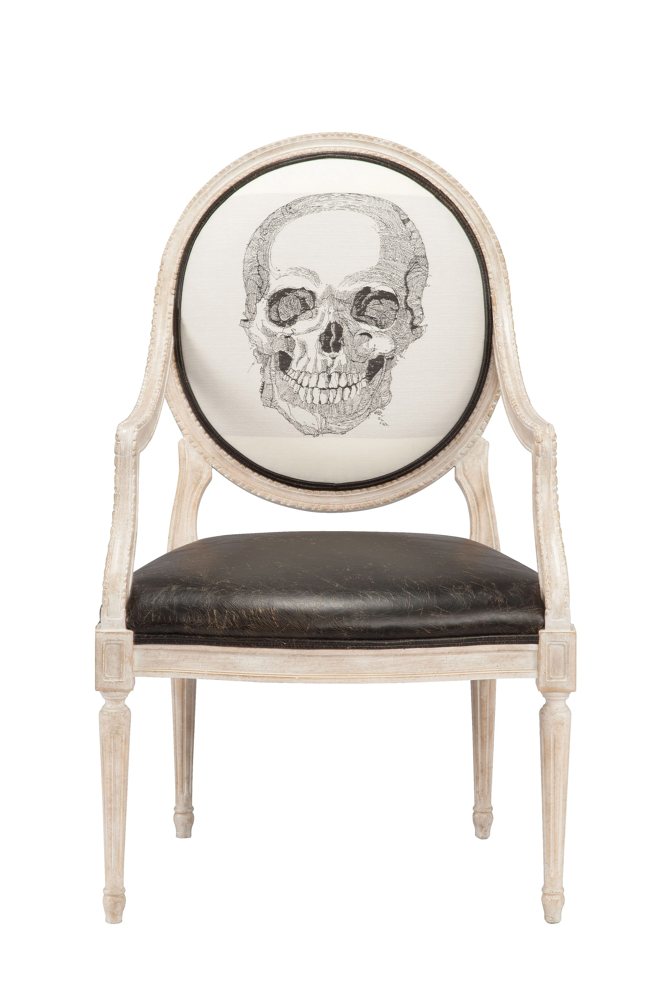 Here's looking at you: Skull lamp and chair with skull upholstery are from Currey & Company.
